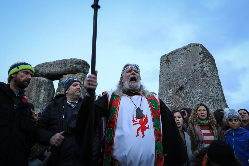 Arthur Pendragon speaks with the crowd as Druids, Pagans and revelers gather in the center of Stonehenge, hoping to see the sun rise, as they take part in a winter solstice ceremony at Stonehenge on December 22, 2018 in Wiltshire, England.