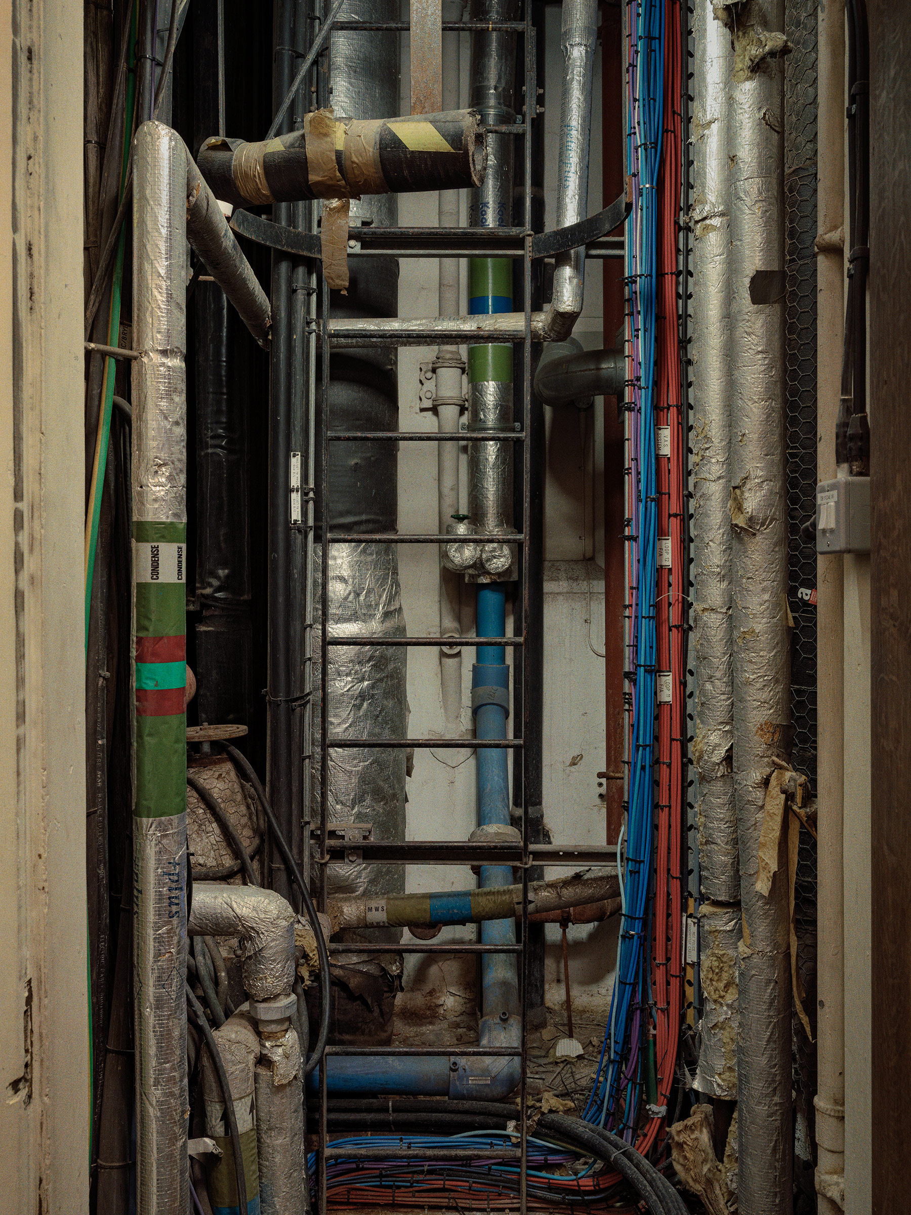 A view of one of the many ventilation shafts inside the Palace of Westminster in London, packed full of cabling.