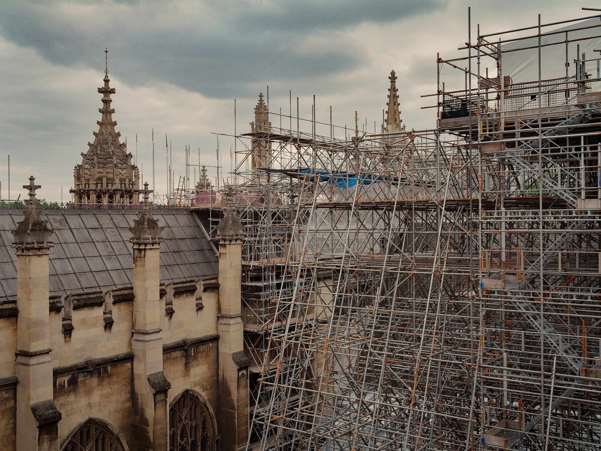 A view from the roof of the Palace of Westminster showing damage to the roof (left) and scaffolding erected for repair work (right).