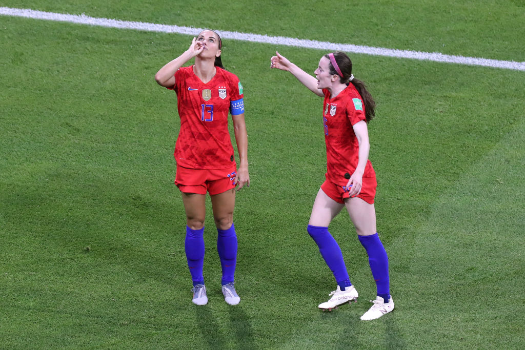 Alex Morgan of USA celebrates scoring their 2nd goal by pretending to drink a cup of tea during the 2019 FIFA Women's World Cup France Semi Final match between England and USA at Stade de Lyon on July 2, 2019 in Lyon, France.