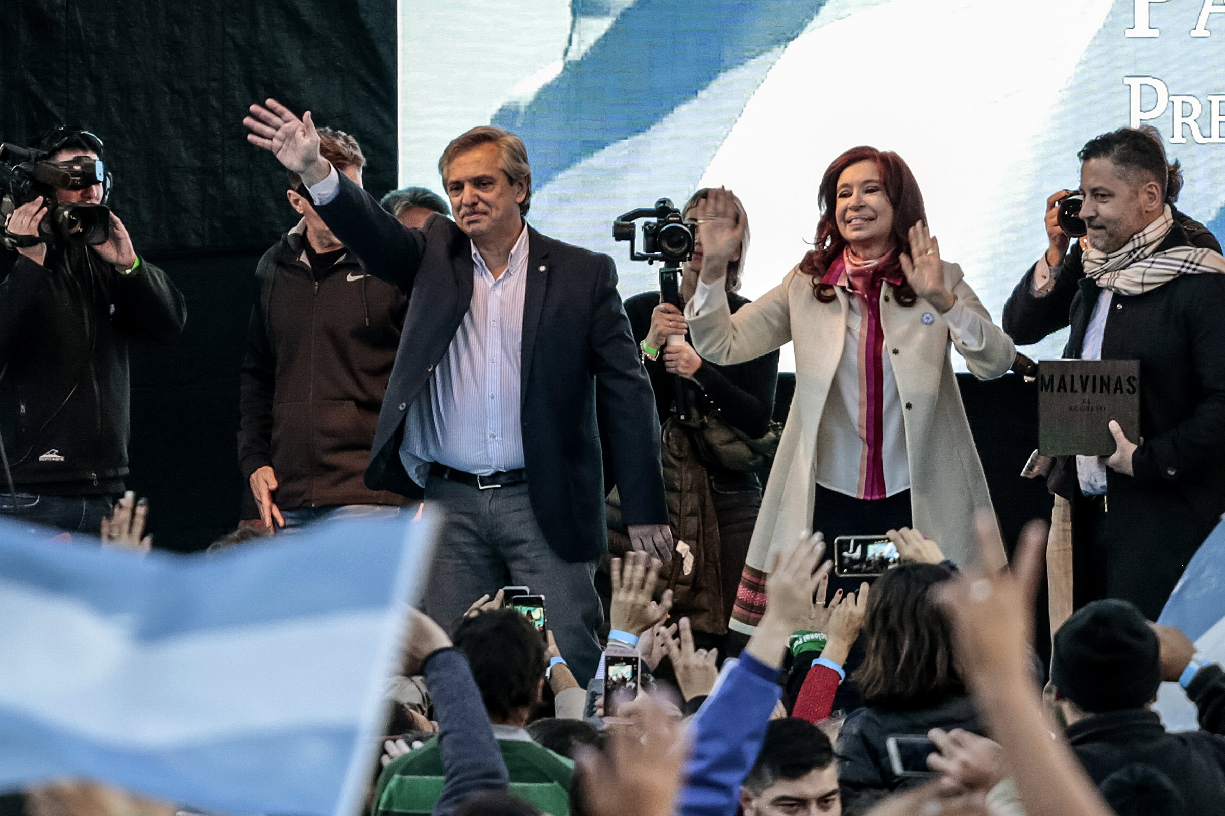 Presidential candidate Alberto Fernandez and former president of Argentina Cristina Fernandez de Kirchner wave to attendees during their first campaign event in Merlo, Argentina, on May 25.