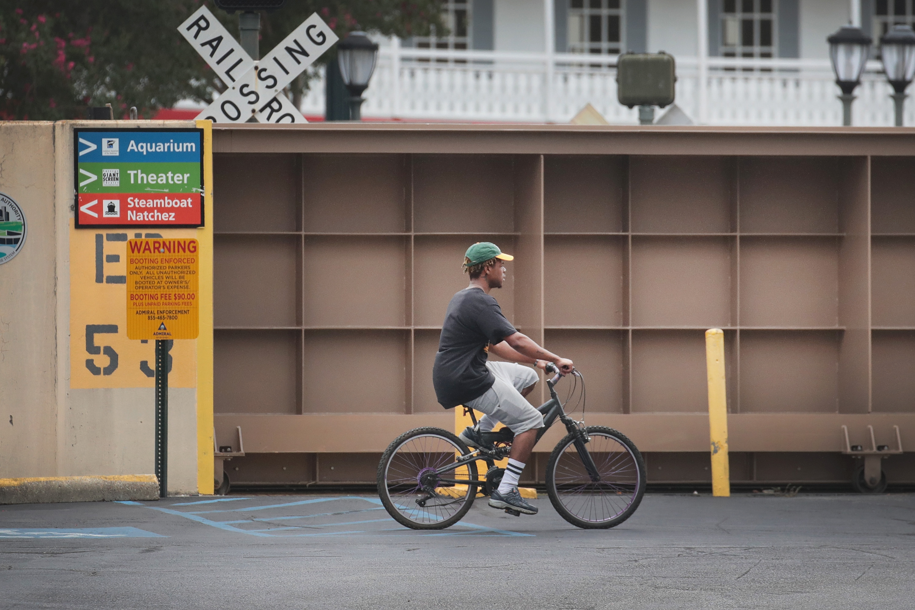 A cyclist rides past a flood gate that has been closed to keep the Mississippi River from inundating the French Quarter with storm surge from Hurricane Barry on July 12, 2019 in New Orleans, Louisiana.