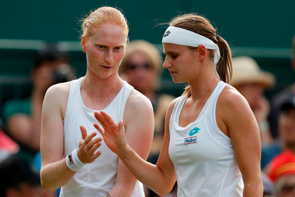 Belgium's Greet Minnen (R) and Belgium's Alison van Uytvanck talk during their women's doubles second round match on the fifth day of the  Wimbledon Championships in southwest London, on July 5, 2019. The pair made history as the first ever gay couple to compete together at the tournament.