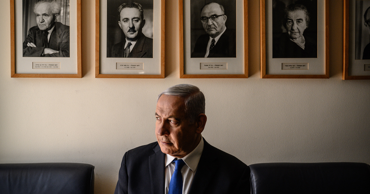 Netanyahu in his Jerusalem office, with portraits of Israel's early Prime Ministers, starting with David Ben-Gurion, top left.