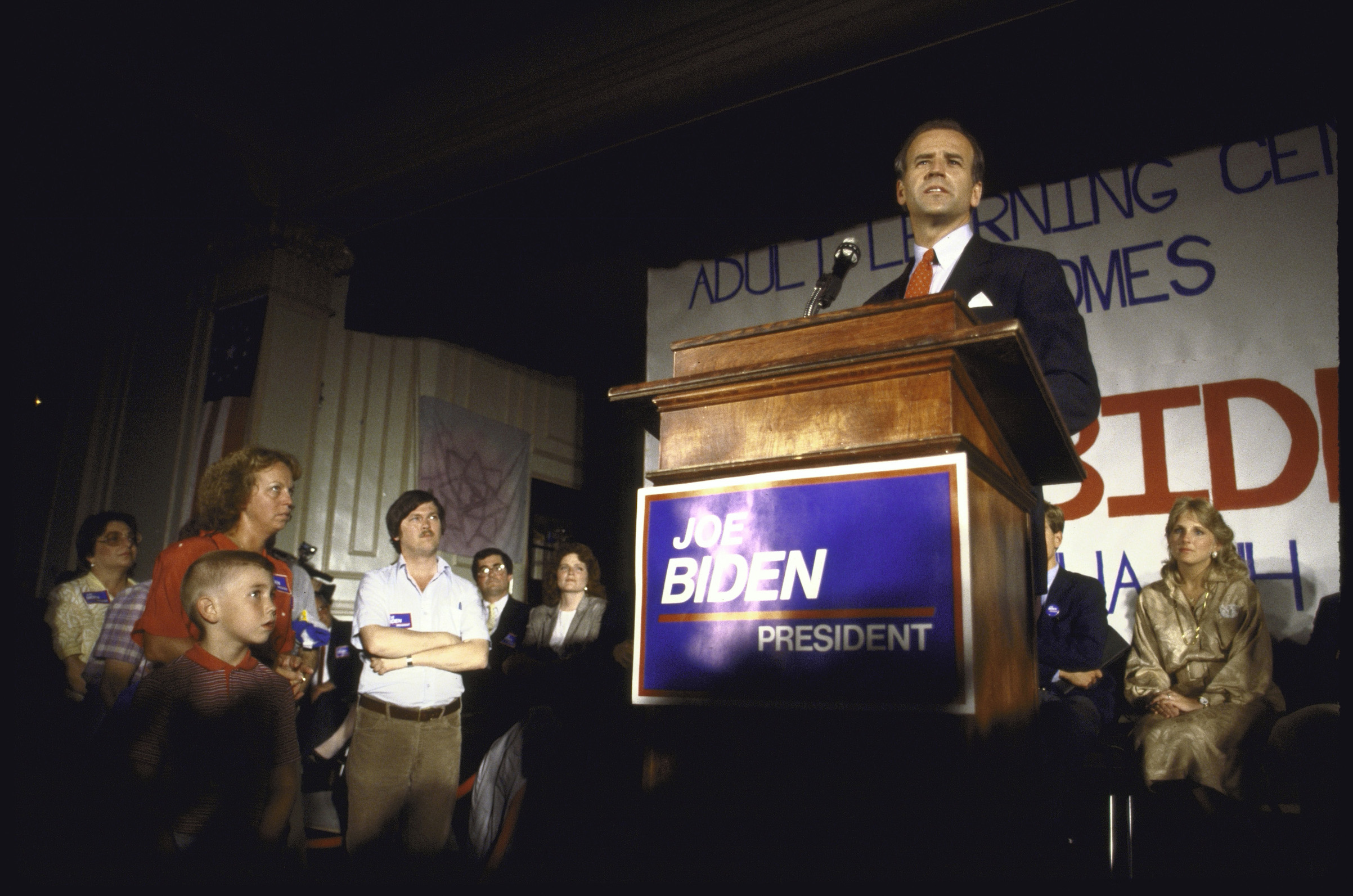 Sen. Joseph R. Biden Jr. announcing his bid for 1988 Democratic presidential nomination as wife Jill (R) looks on.