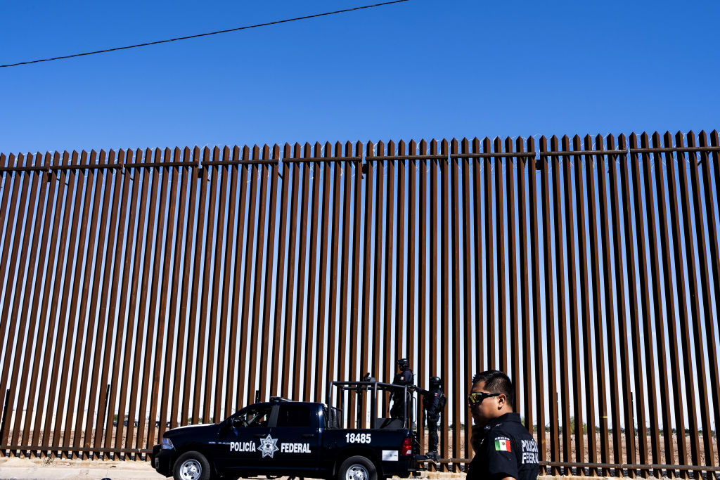 Mexican Federal Police patrol along a fence ahead of U.S. President Donald Trump's visit to Calexico, California, across from the U.S.-Mexico border in Mexicali, Mexico, on Friday, April 5, 2019.