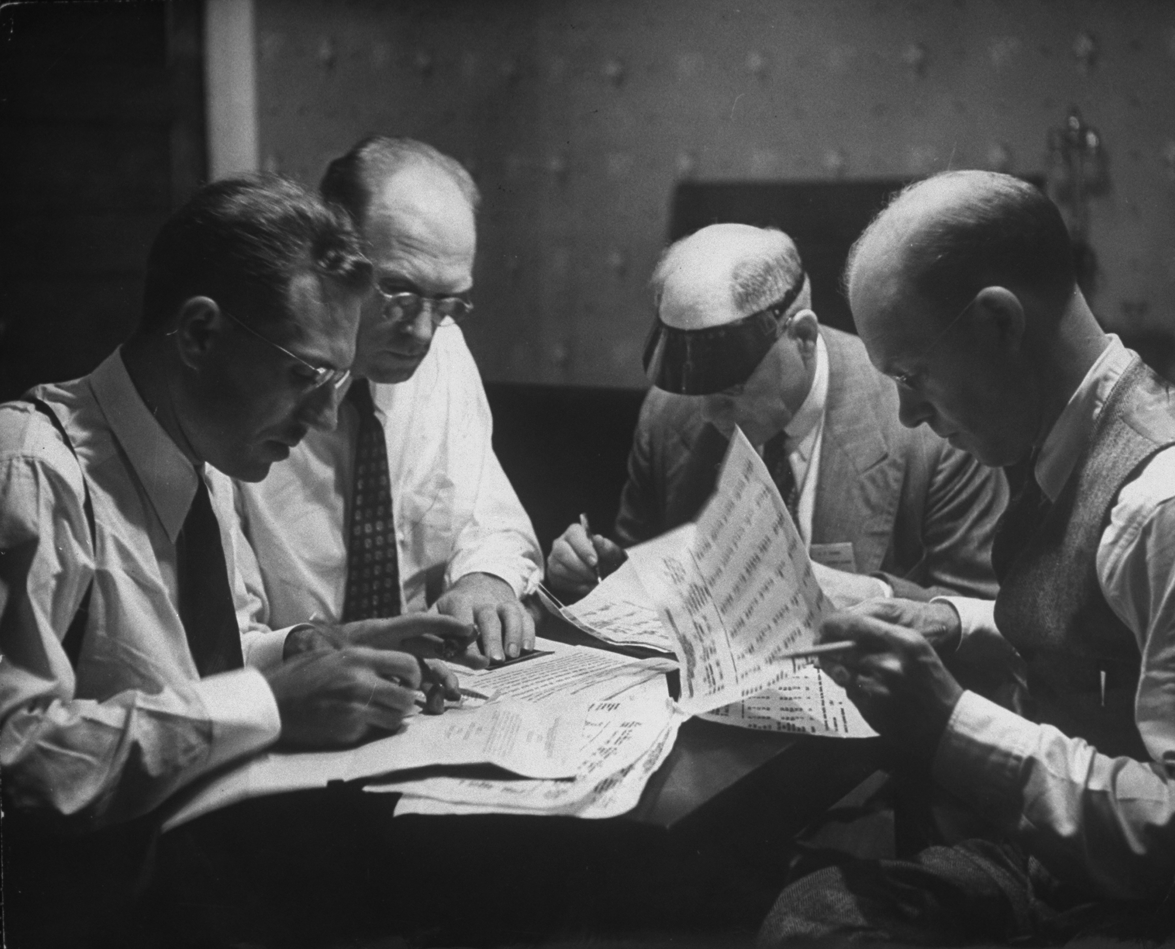 American delegation subcommittee working at night on statistical report during the international monetary conference to plan for postwar reconstruction; July 1, 1944