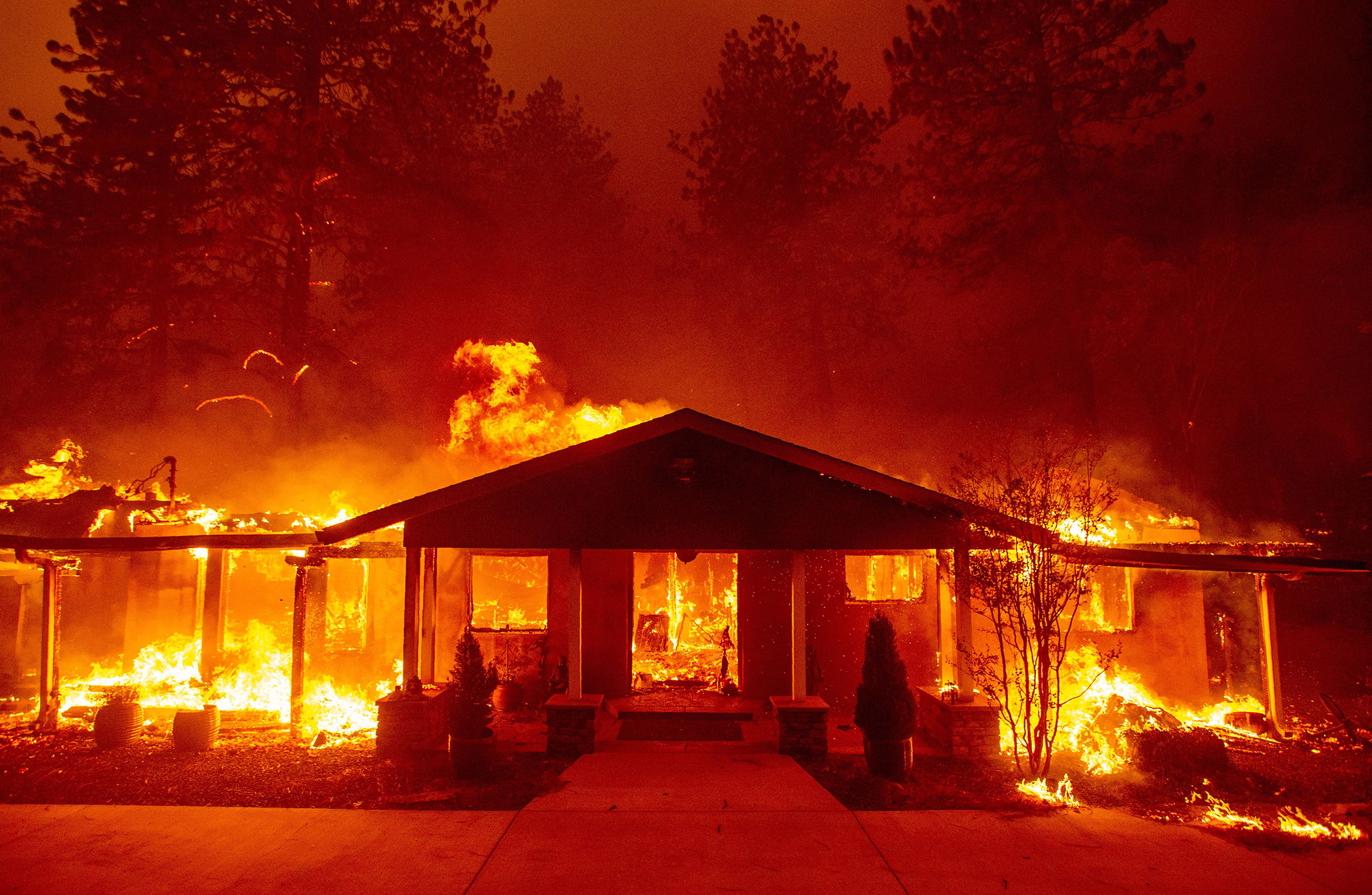 A home burns during the Camp fire in Paradise, California on Nov. 8, 2018.