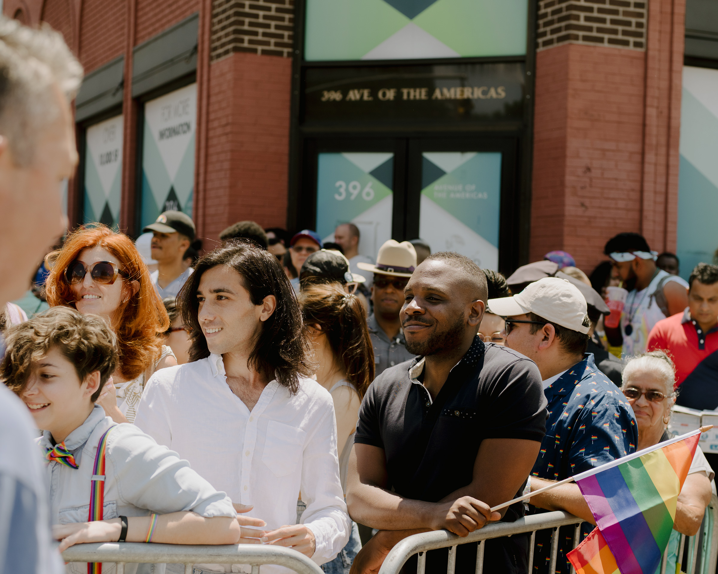 Amin Dzhabrailov and Kimahli Powell, executive director of the Rainbow Railroad organization, watch the Pride parade in New York on June 30, 2019.