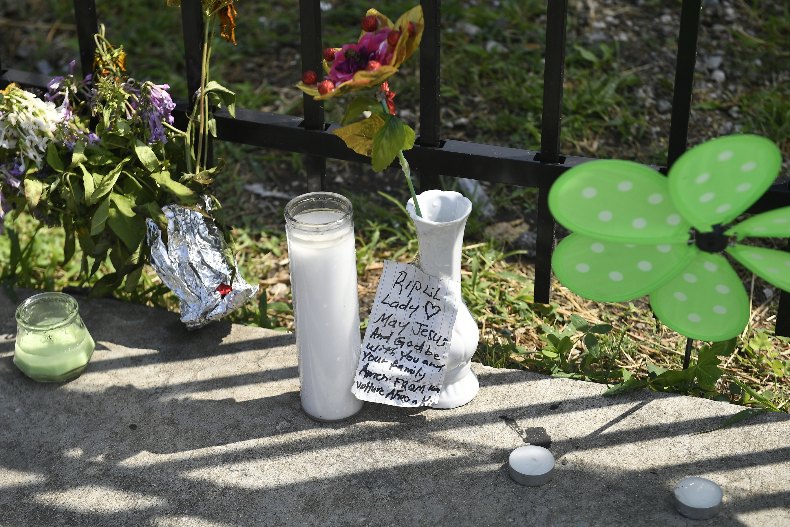 A memorial stands at 75th Street and Stewart Avenue, in Chicago, Tuesday, July 30, 2019  where two women were slain in a drive-by shooting Friday night.