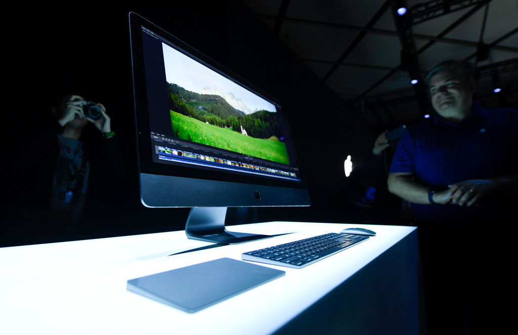 Attendees look at the new Apple iMac Pro desktop computers the 2017 Apple Worldwide Developer Conference (WWDC) at San Jose Convention Center on June 5, 2017 in San Jose, California, America.