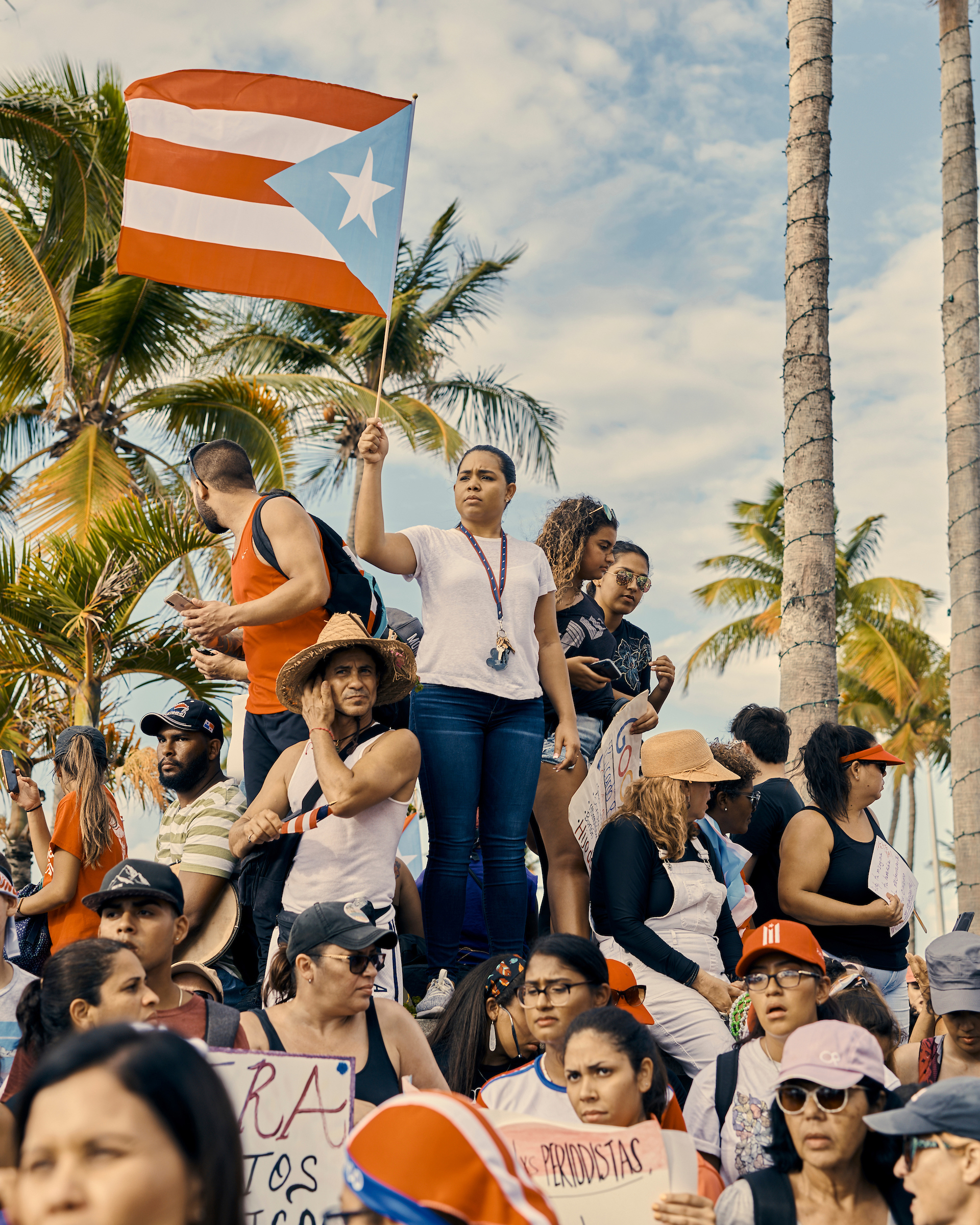A woman waves a Puerto Rican flag at the anti-Rosselló protest in San Juan, Puerto Rico, on July 17, 2019.