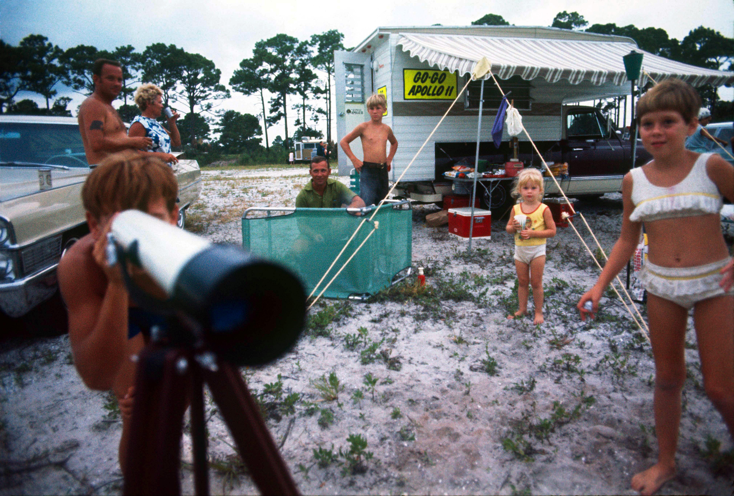 Families camping in Titusville, Florida keep a close watch on the Apollo 11 launch site.