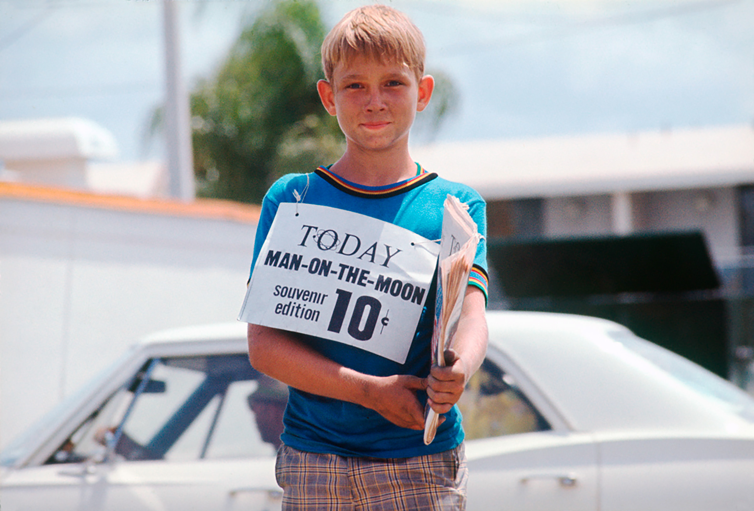 A young boy sells souvenirs in Titusville, Florida.