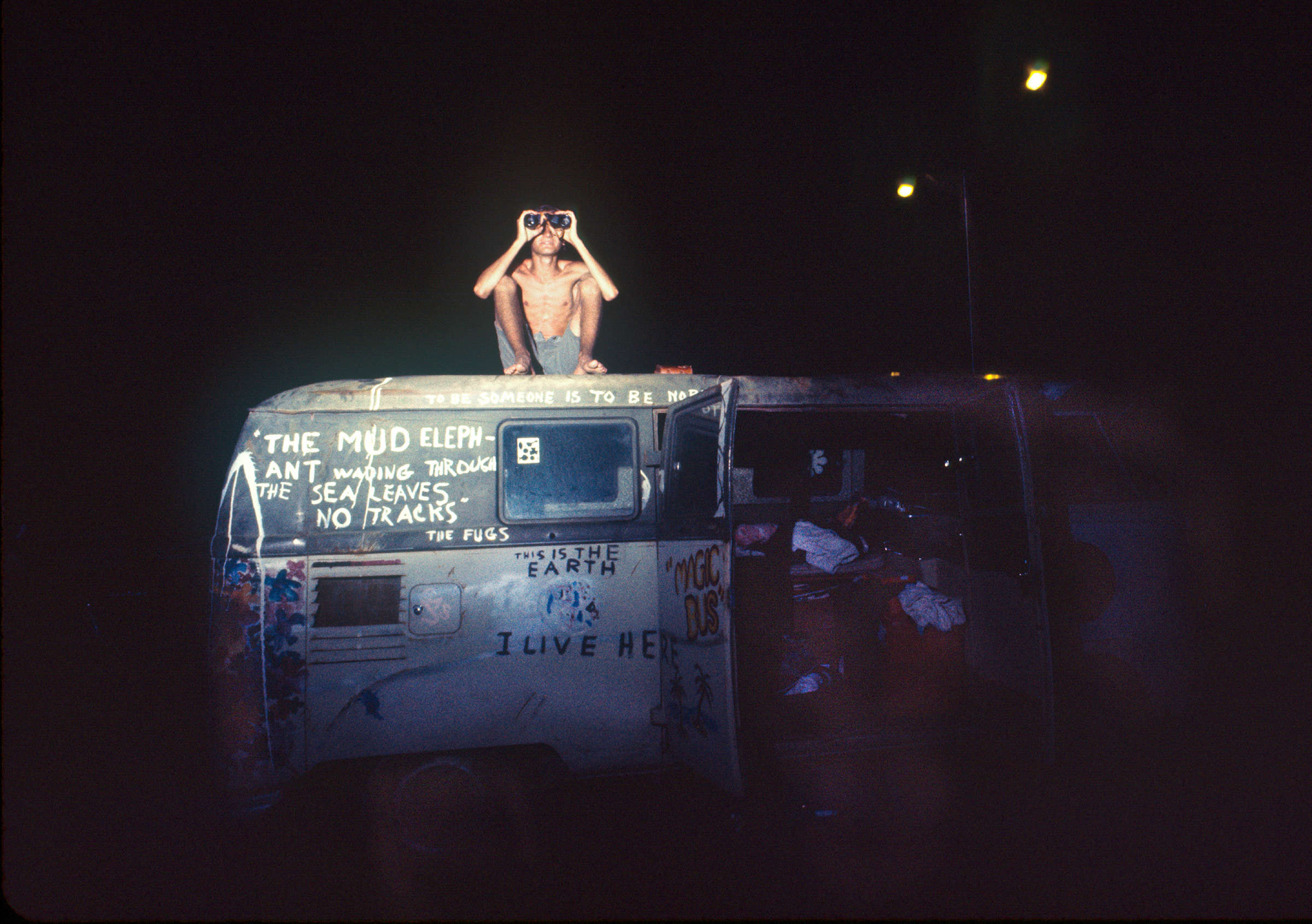 A camper tries to get a better view of the Apollo 11 launch site.