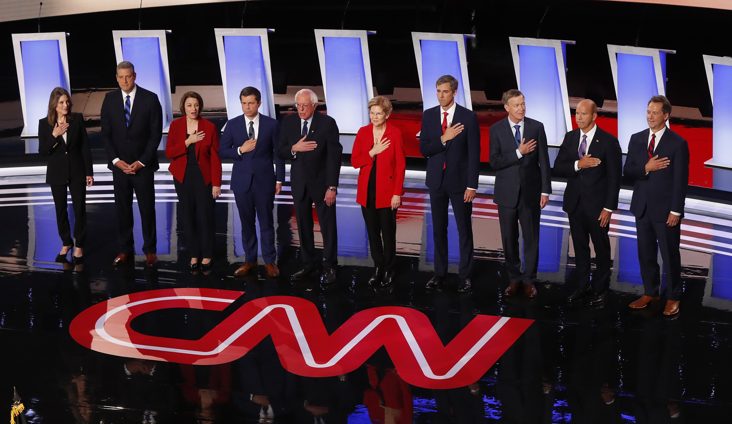 From left, Marianne Williamson, Rep. Tim Ryan, D-Ohio, Sen. Amy Klobuchar, D-Minn., South Bend Mayor Pete Buttigieg, Sen. Bernie Sanders, I-Vt., Sen. Elizabeth Warren, D-Mass., former Texas Rep. Beto O'Rourke, former Colorado Gov. John Hickenlooper, former Maryland Rep. John Delaney and Montana Gov. Steve Bullock take the stage for the first of two Democratic presidential primary debates hosted by CNN Tuesday, July 30, 2019, in the Fox Theatre in Detroit.