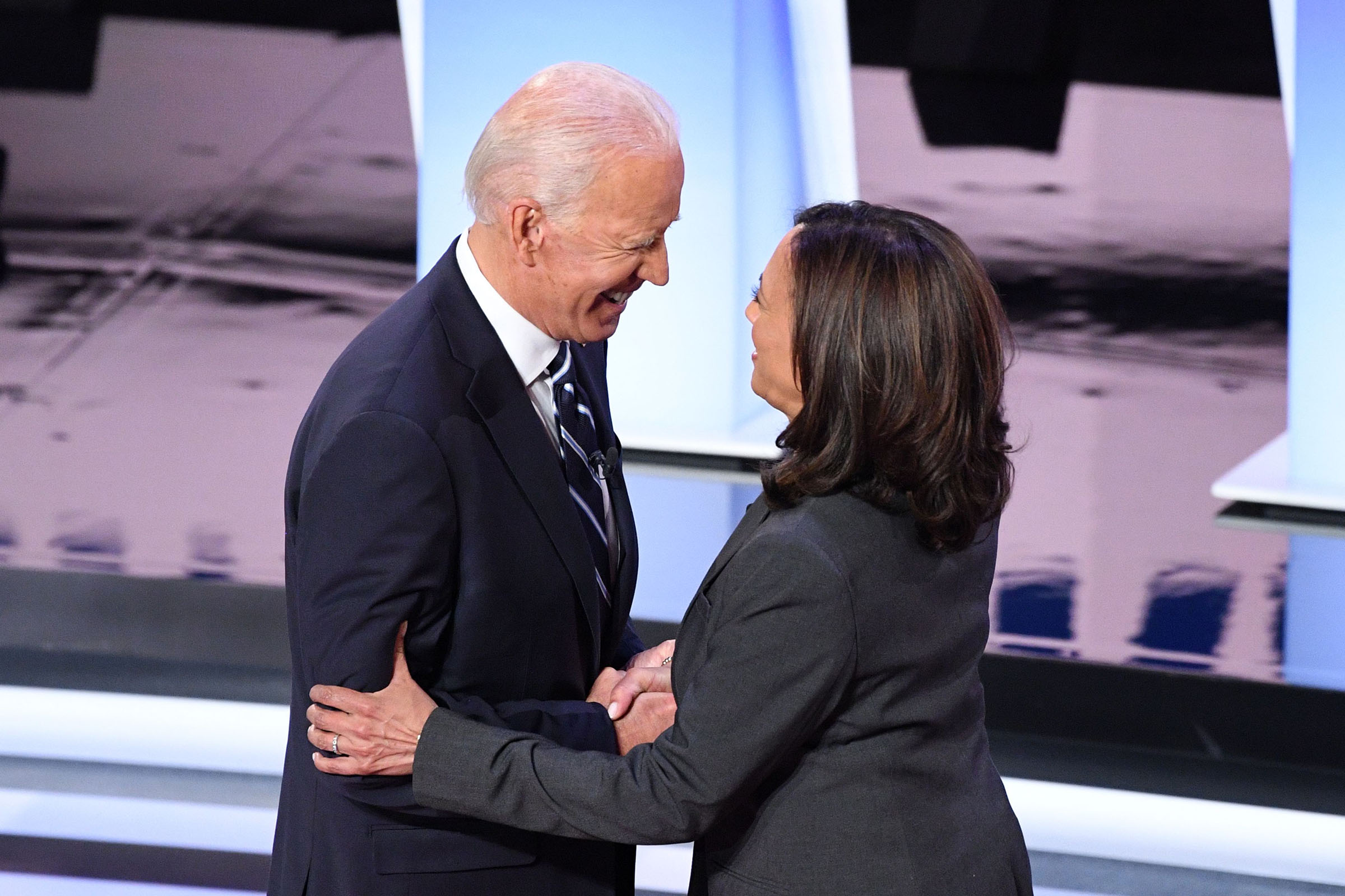 Democratic presidential hopefuls former Vice President Joe Biden (L) and US Senator from California Kamala Harris greet each other ahead of the second round of the second Democratic primary debate of the 2020 presidential campaign season hosted by CNN at the Fox Theatre in Detroit, Michigan on July 31, 2019.