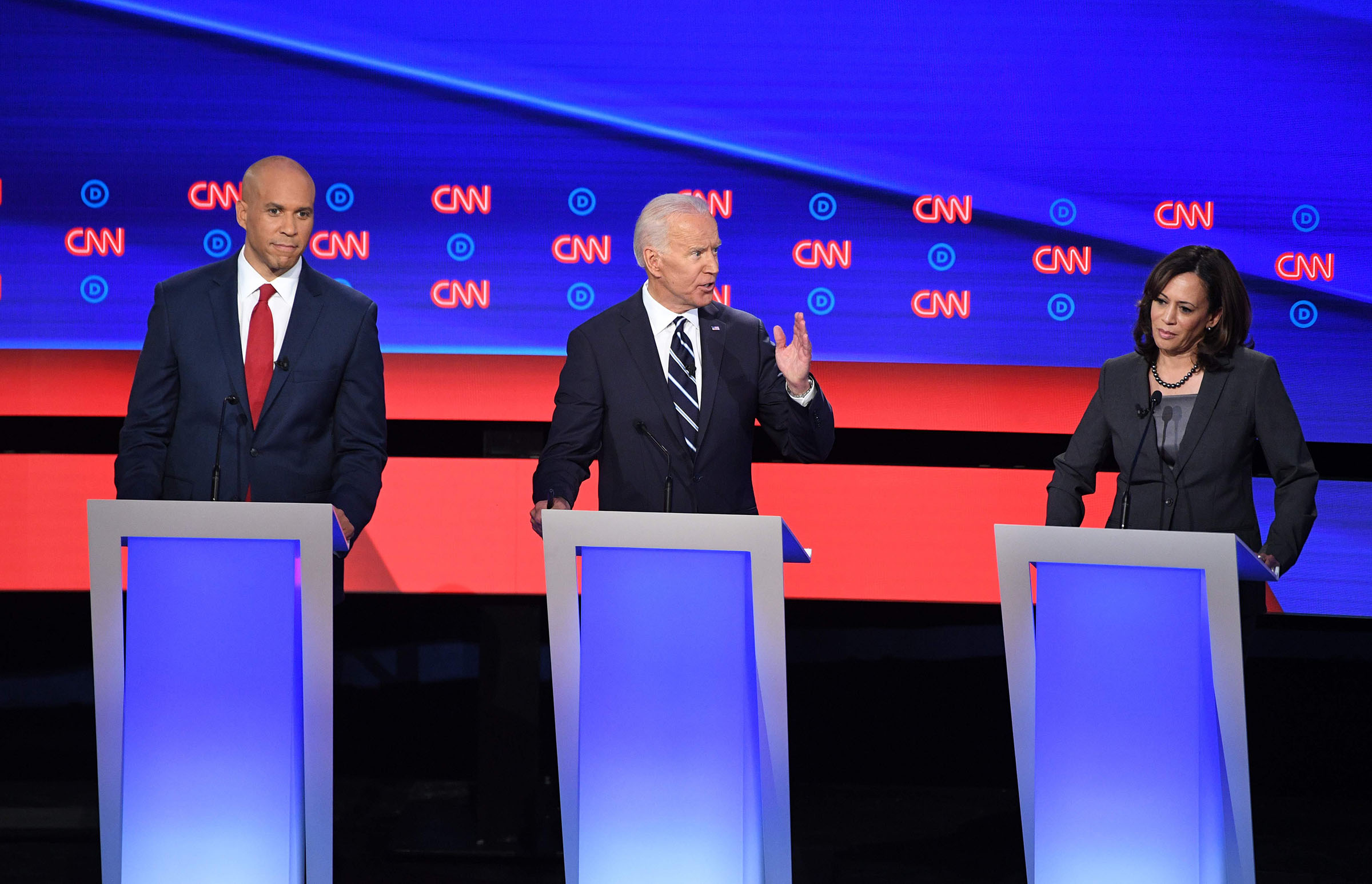 Democratic presidential hopefuls (fromL) US Senator from New Jersey Cory Booker looks on as former Vice President Joe Biden gestures next to US Senator from California Kamala Harris during the second round of the second Democratic primary debate of the 2020 presidential campaign season hosted by CNN at the Fox Theatre in Detroit, Michigan on July 31, 2019.