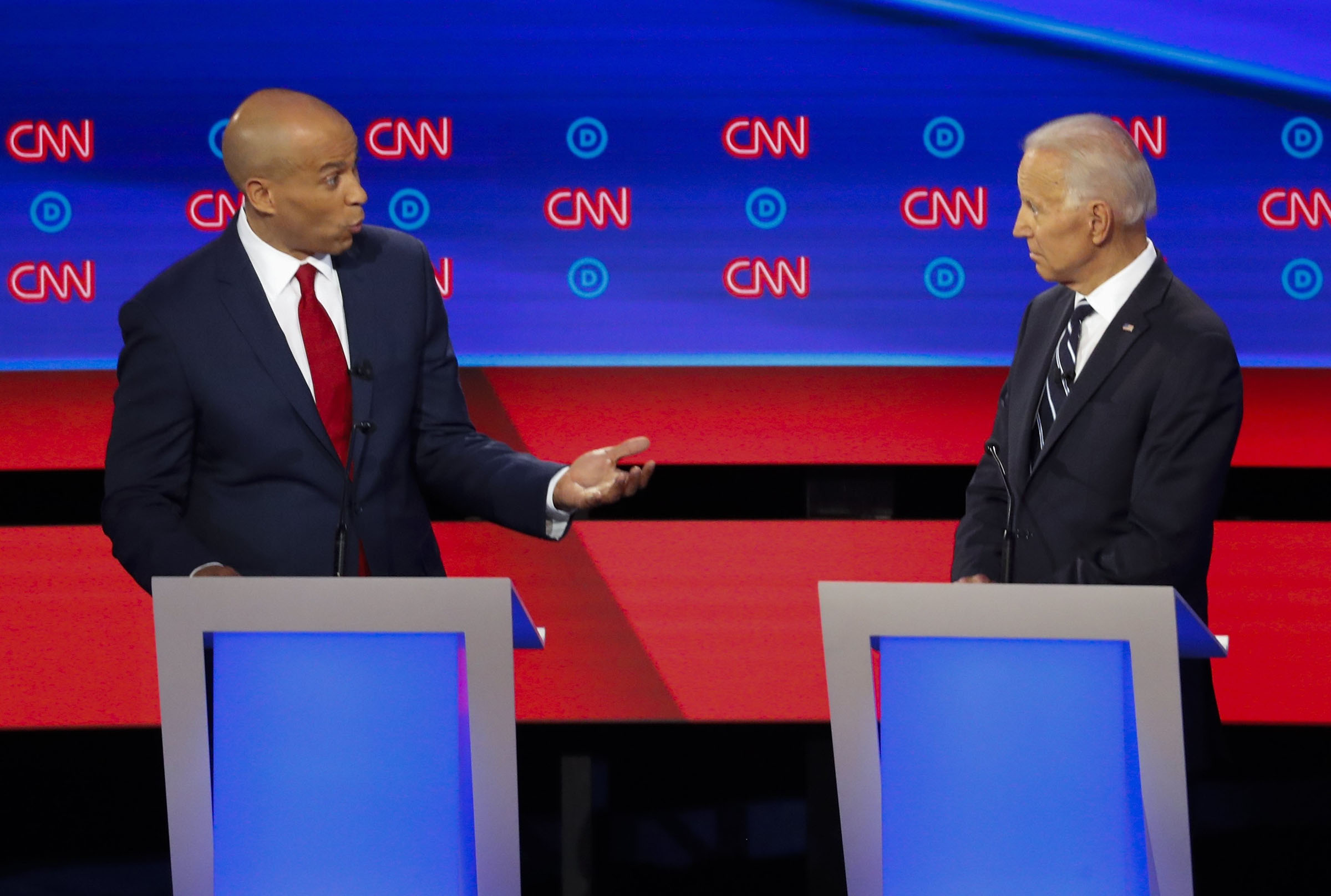 Sen. Cory Booker, D-N.J., speaks to former Vice President Joe Biden as they participate in the second of two Democratic presidential primary debates hosted by CNN Wednesday, July 31, 2019, in the Fox Theatre in Detroit.