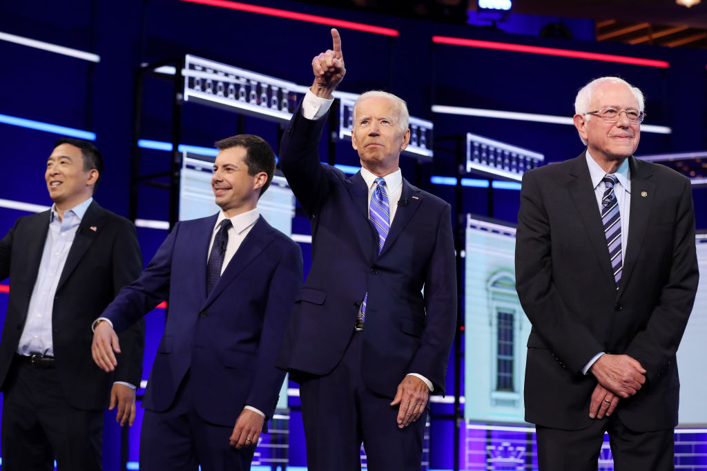 Democratic presidential candidates former tech executive Andrew Yang, South Bend, Indiana Mayor Pete Buttigieg, former Vice President Joe Biden and Sen. Bernie Sanders (I-VT) take the stage for the second night of the first Democratic presidential debate on June 27, 2019 in Miami, Florida.