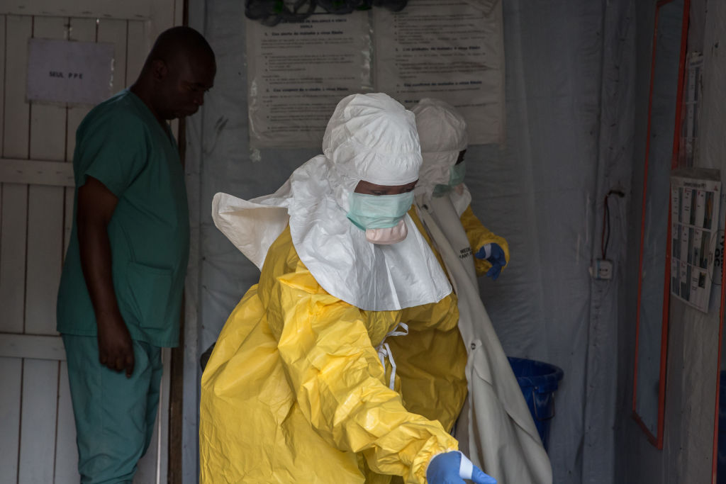 Medical staff dressed in protective gear before entering an isolation area at an Ebola treatment centre in Goma.