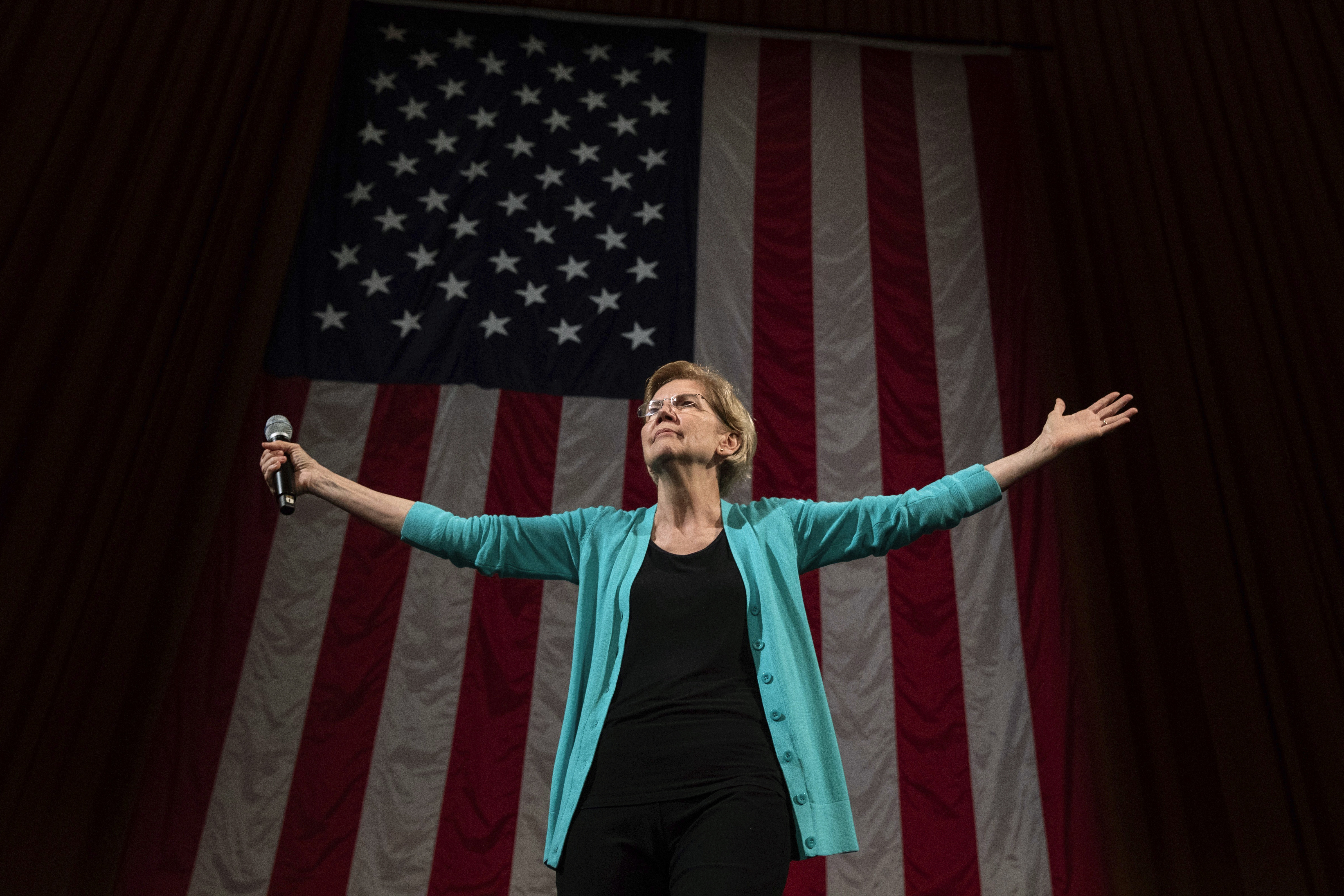 In this June 28, 2019 photo, Democratic presidential candidate Sen. Elizabeth Warren, D-Mass., arrives at Chicago's Auditorium Theater at Roosevelt University for a Chicago Town Hall event.