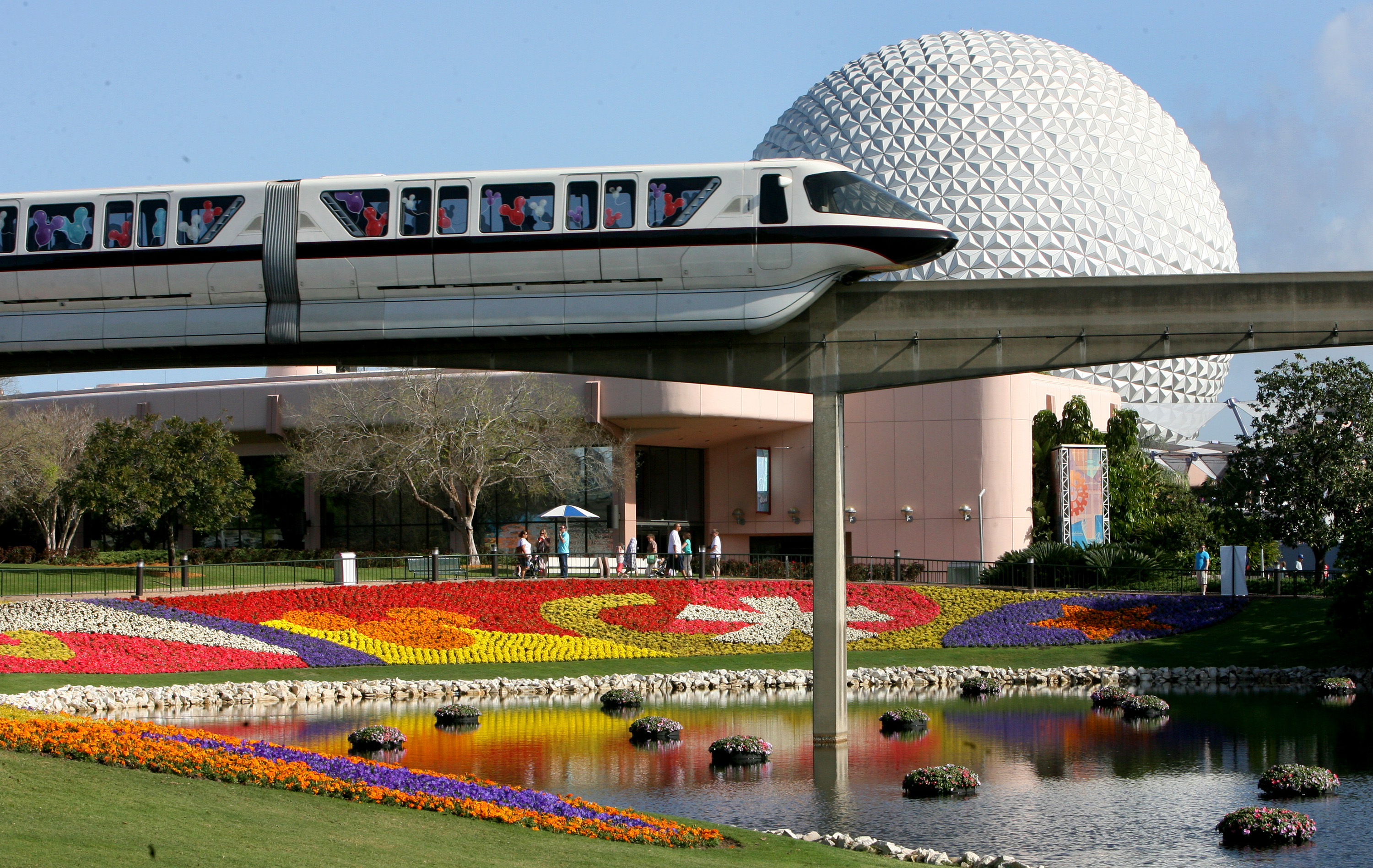 In this March 19, 2009 file photo, a Disney World monorail passes Spaceship Earth at Walt Disney World's Epcot Center in Lake Buena Vista, Fla.