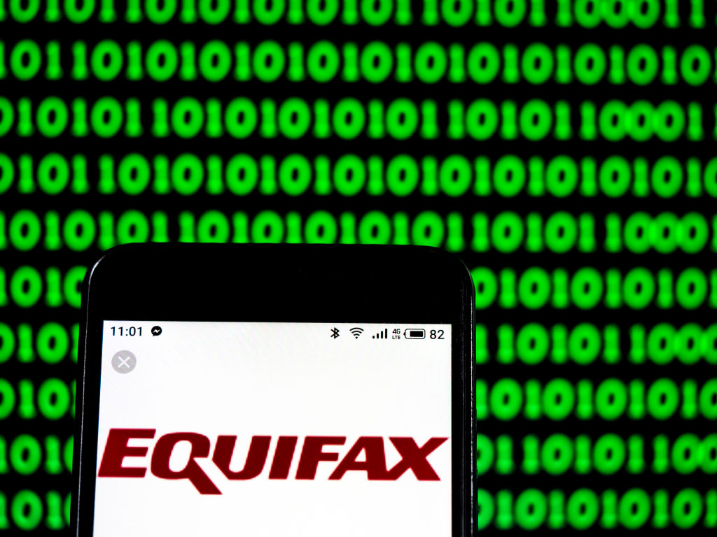 The Equifax Consumer reporting agency company logo seen displayed on a smartphone.