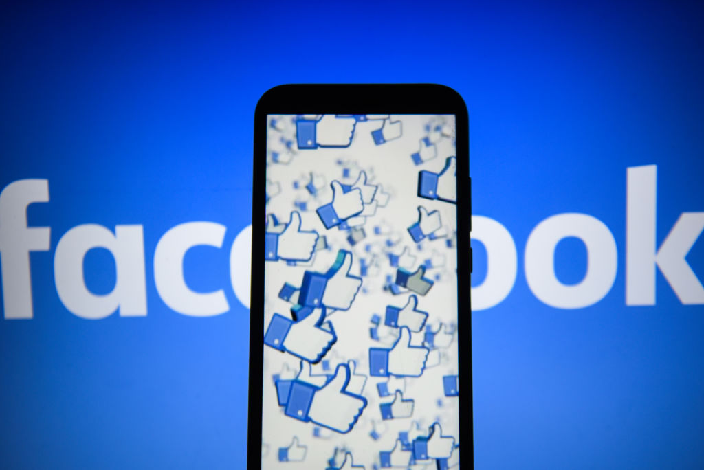 In this photo illustration, the Facebook likes logo are seen displayed on an Android mobile phone.