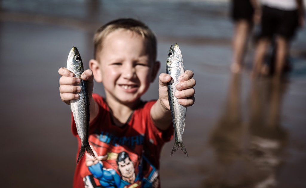 The Kid Who Bit the Fish in the Family Photo Has Gone Viral | Time