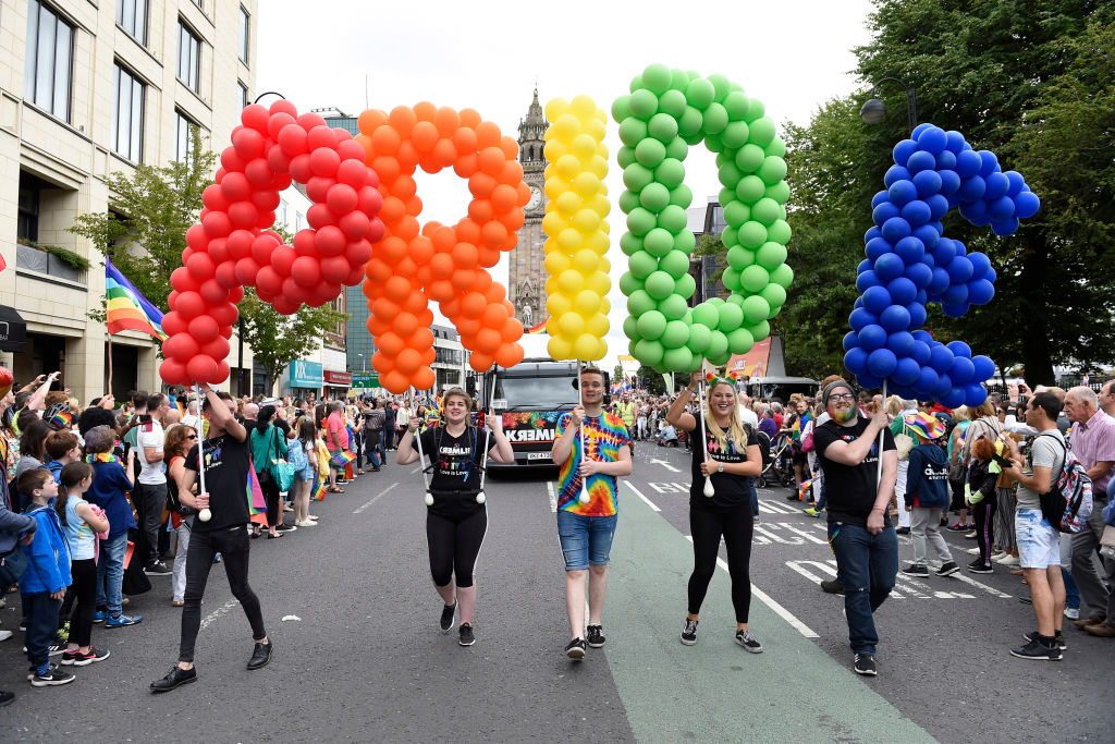 People taking part in the Belfast Pride parade set off from Custom House Square in central Belfast.