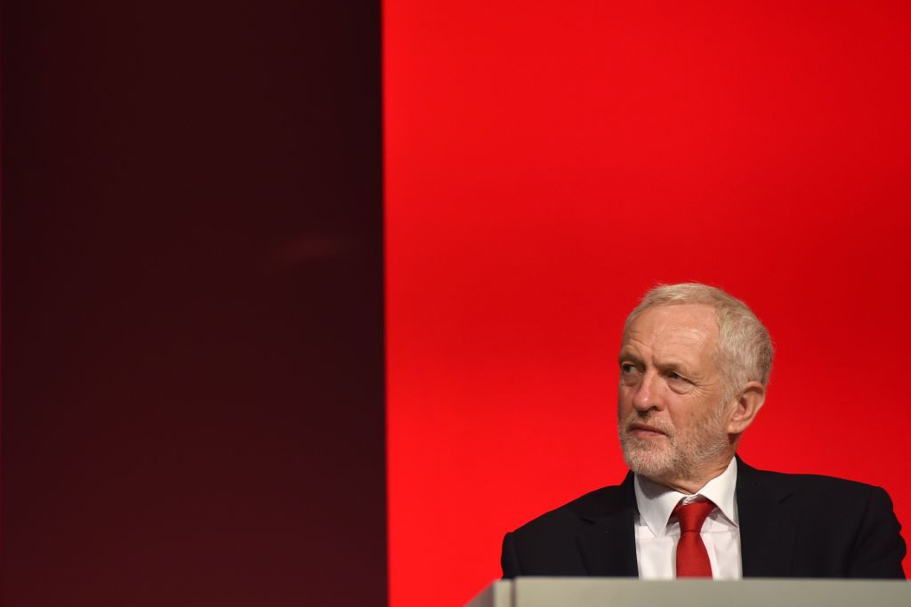 Britain's opposition Labour Party leader Jeremy Corbyn listens to a speech at the Labour Party Conference in Liverpool, north west England on September 23, 2018.