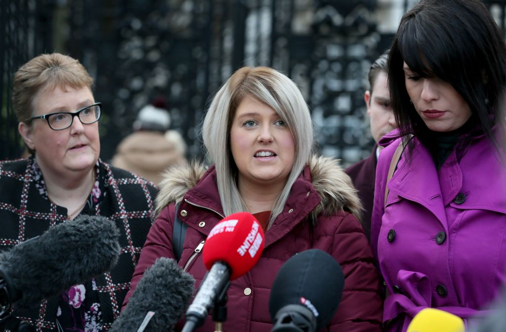 Northern Ireland resident and campaigner Sarah Ewart (C), who after having been diagnosed with a fatal foetal abnormality in 2013 travelled to England for a termination, with her mother stands with her mother Jane Christie (L) and Amnesty International's Grainne Teggart, as she speaks to members of the media after arriving at Belfast High court in Belfast, on January 30, 2019.