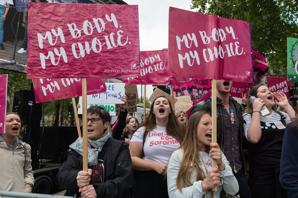 Pro-choice supporters stage a demonstration in Parliament Square to campaign for women's reproductive rights, legalisation of abortion in Northern Ireland and its decriminalisation in the UK on 11 May, 2019 in London, England.