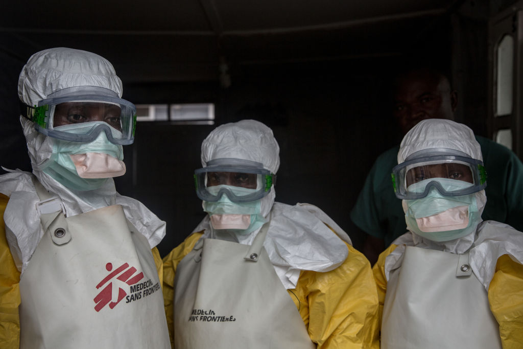 Medical staff dressed in protective gear before entering an isolation area at an Ebola treatment centre in Goma, DRC