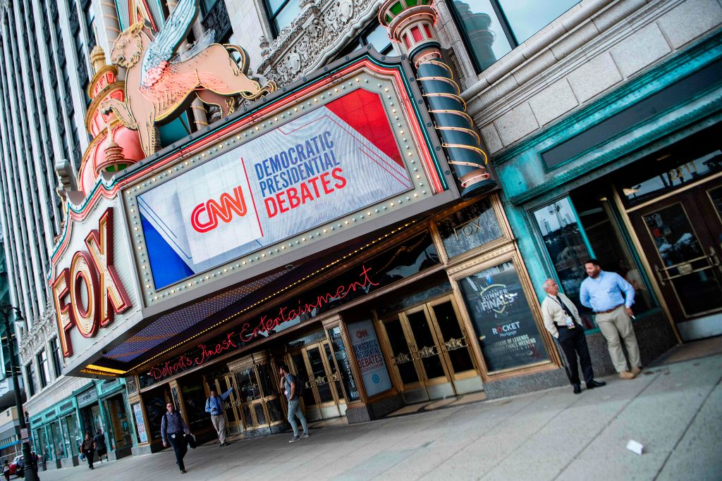 People stand outside the Fox Theatre ahead of the democratic debates in Detroit, Michigan on July 29, 2019.