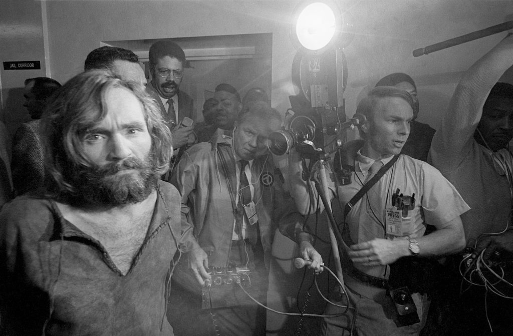 Cameramen film the scene as Charles Manson is brought into the Los Angeles city jail under suspicion of having masterminded the Tate-LaBianca murders of August 1969.