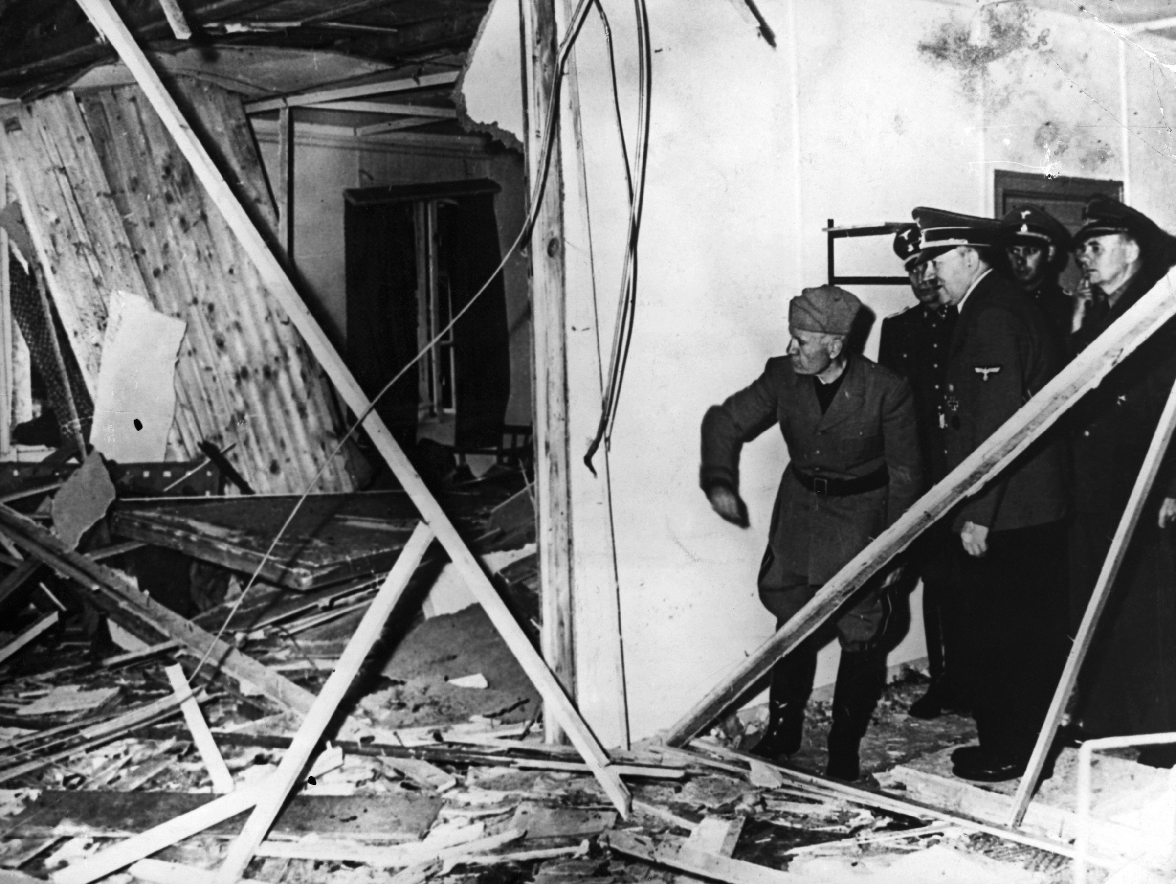 Adolf Hitler and Benito Mussolini visit Hitler's damaged headquarters in East Prussia after an attempt on Hitler's life there in July 1944. Colonel Claus von Stauffenberg and several other high-ranking Nazi staff members planned and carried out the attempt, and were executed for it.