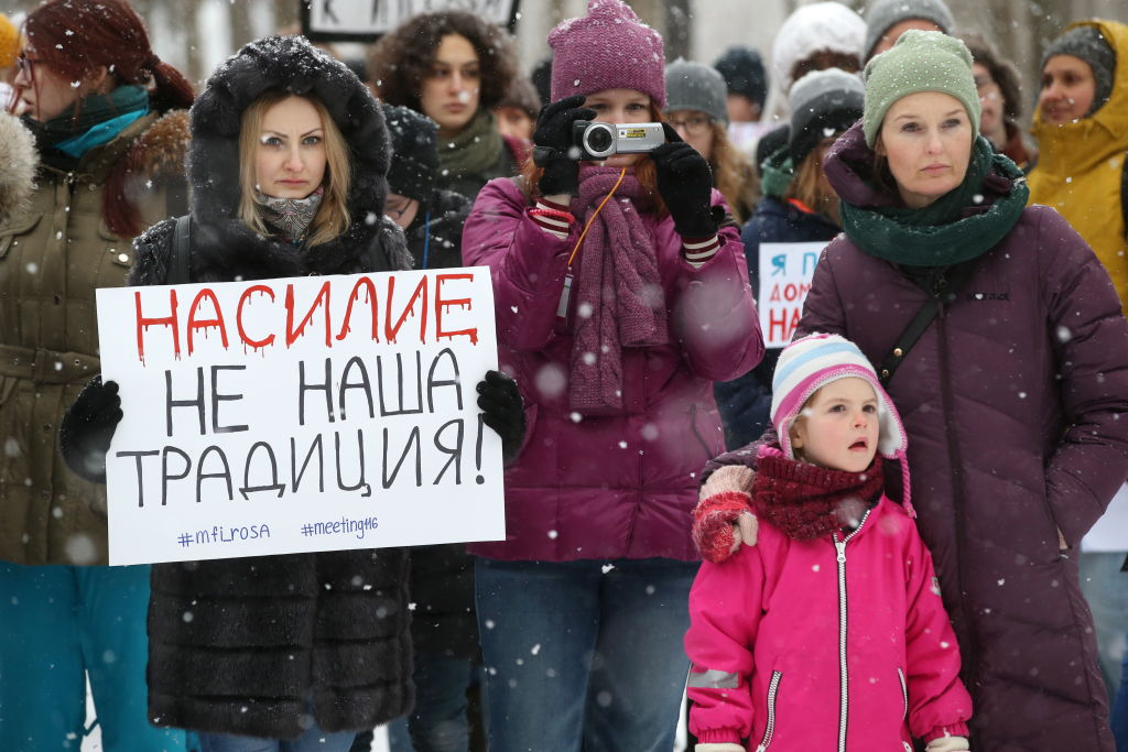 People gather in Moscow's Sokolniki Park to protest against a bill decriminalizing domestic violence, signed into law by Russia's President Vladimir Putin on February 7, 2017.