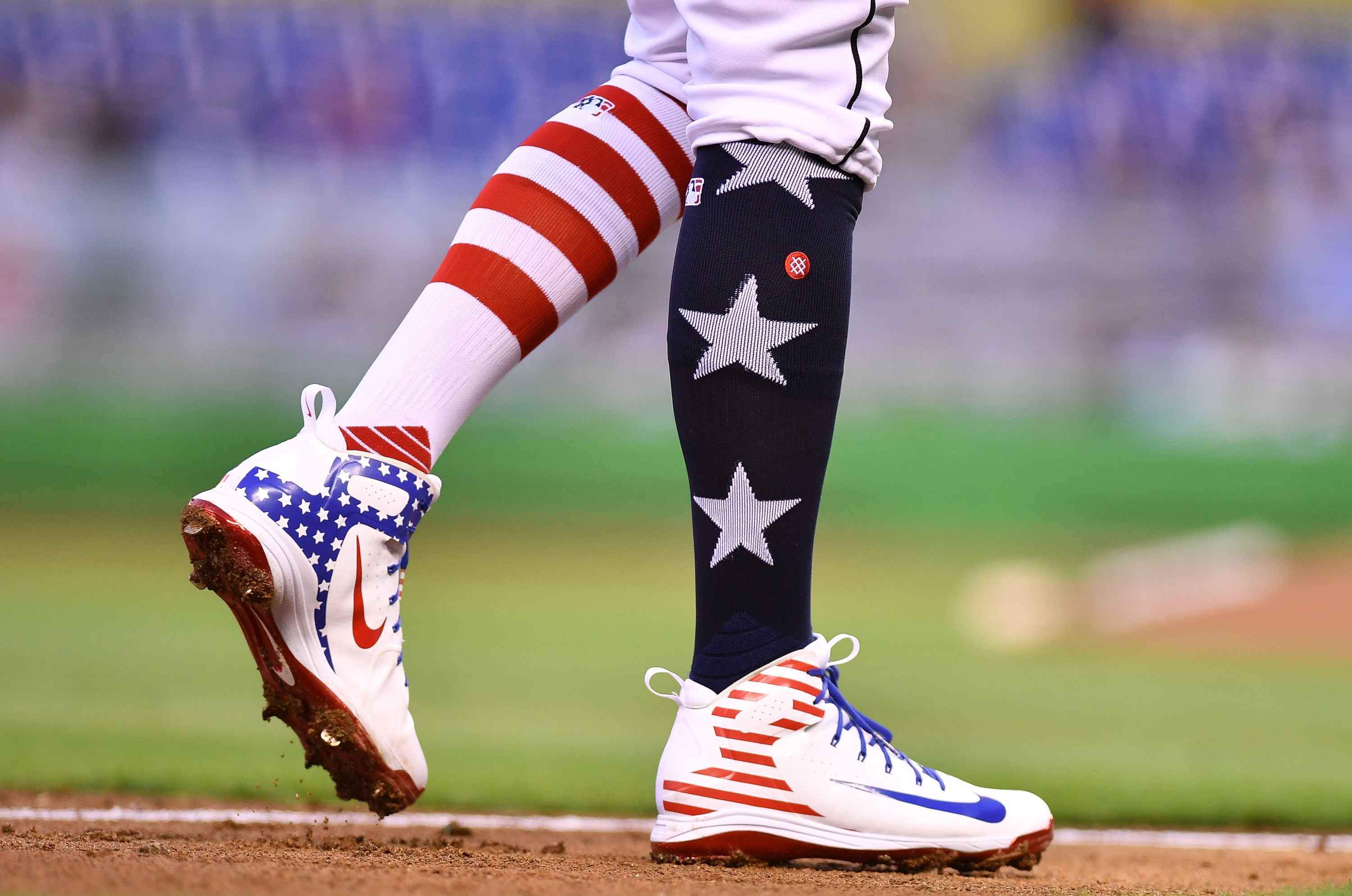 MIAMI, FL - JULY 02: A detailed view of the Stars and Stripes edition Nike cleats and Stance socks worn by Miguel Rojas #19 of the Miami Marlins during the game against the Tampa Bay Rays at Marlins Park on July 2, 2018 in Miami, Florida.