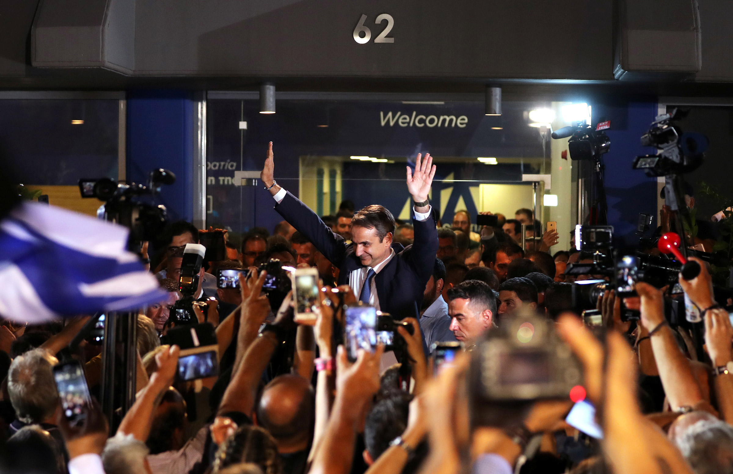 Newly-elected Prime Minister Kyriakos Mitsotakis waves as he speaks outside the New Democracy party headquarters after winning the general election on July 7 in Athens, Greece.