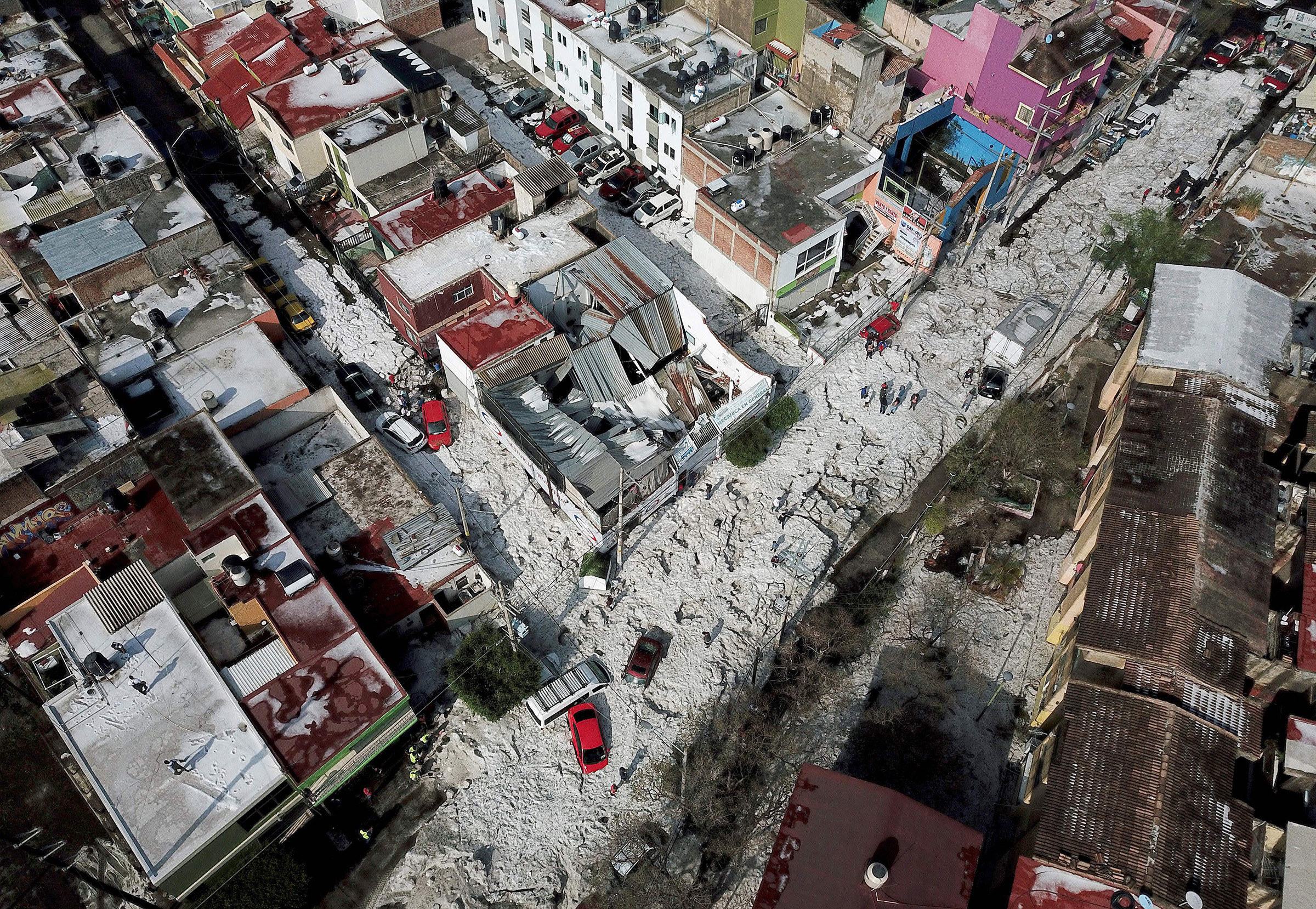 Aerial view of vehicles buried in hail in the streets in the eastern area of Guadalajara, Jalisco state, Mexico, on June 30, 2019.
