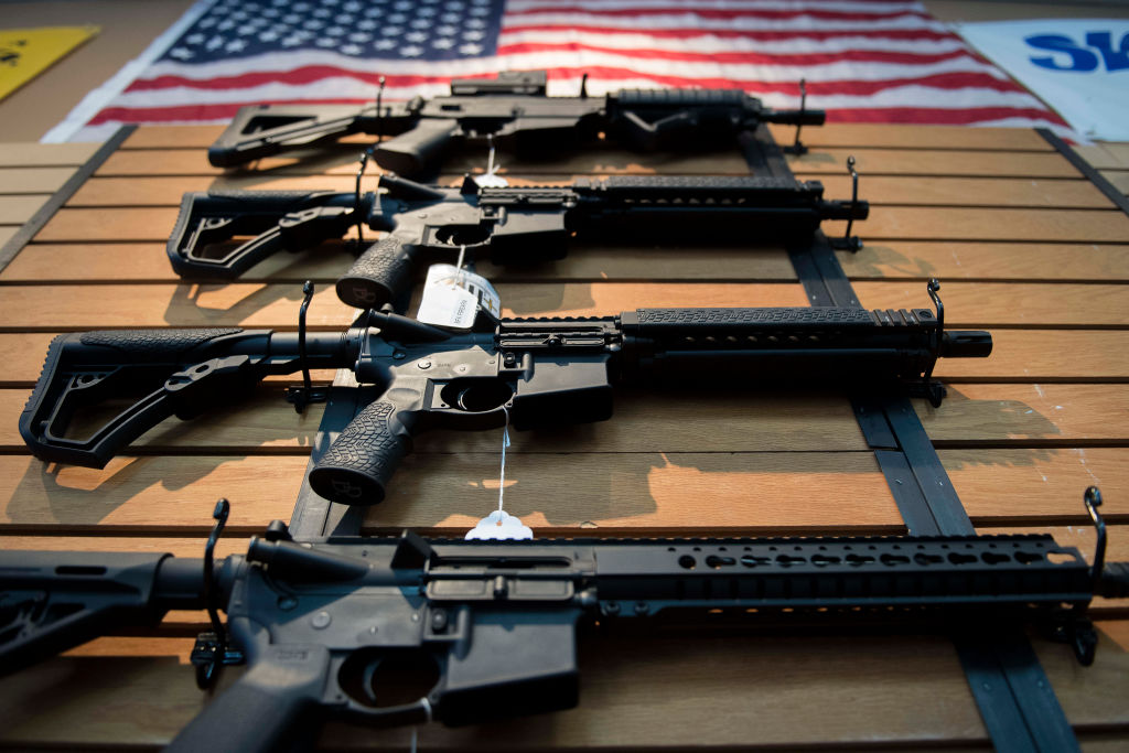 Assault rifles hang on the wall for sale at Blue Ridge Arsenal in Chantilly, Virginia, on Oct. 6, 2017.