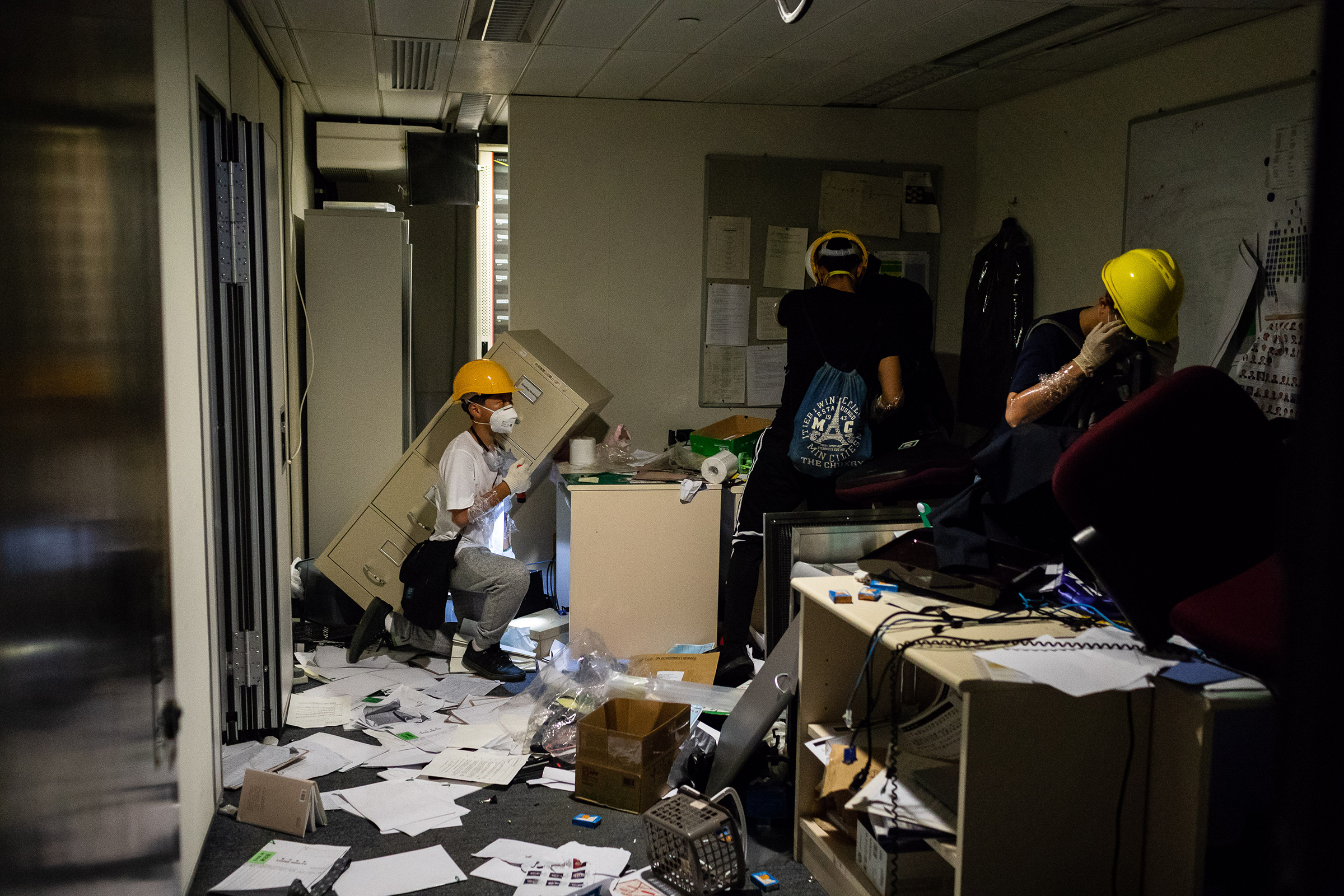 Demonstrators look through items in an office after breaking into the Legislative Council building during a protest in Hong Kong on July 1, 2019.