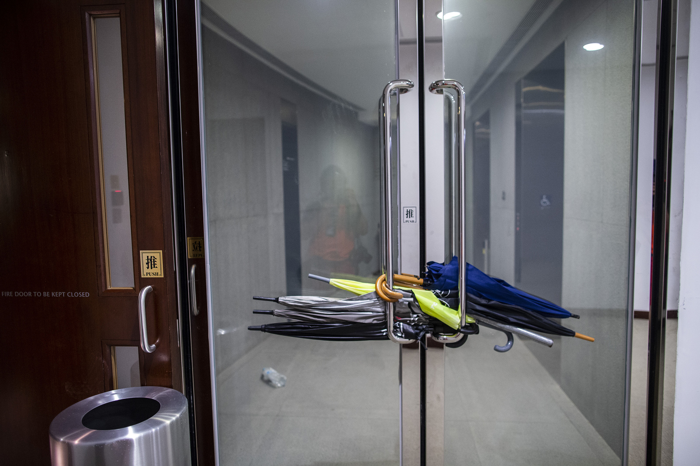 Umbrellas are used to block doors inside the Legislative Council building in Hong Kong on July 1, 2019.