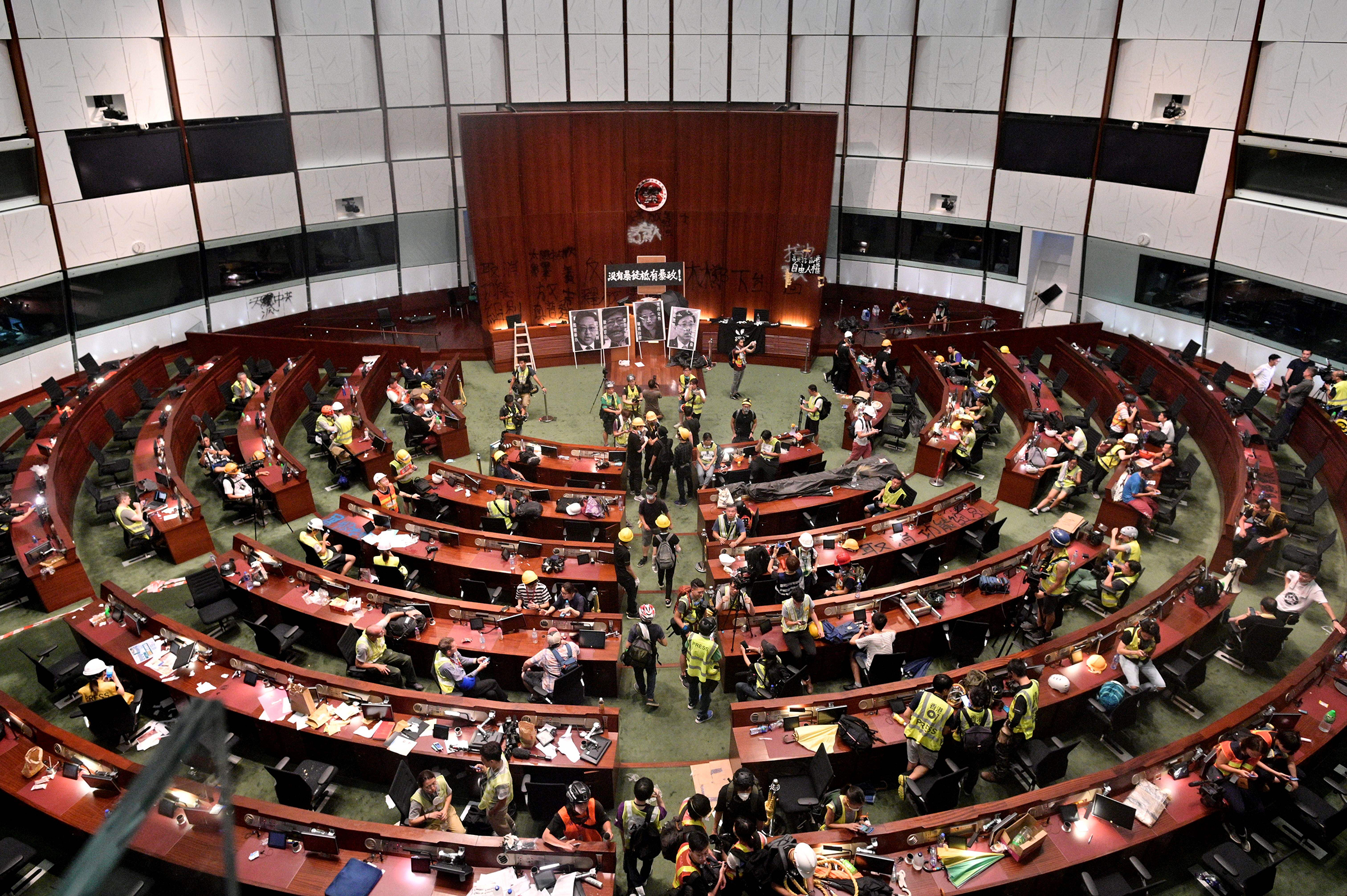 Protesters and members of the media are seen in the chambers after demonstrators broke into the government headquarters in Hong Kong on July 1, 2019.