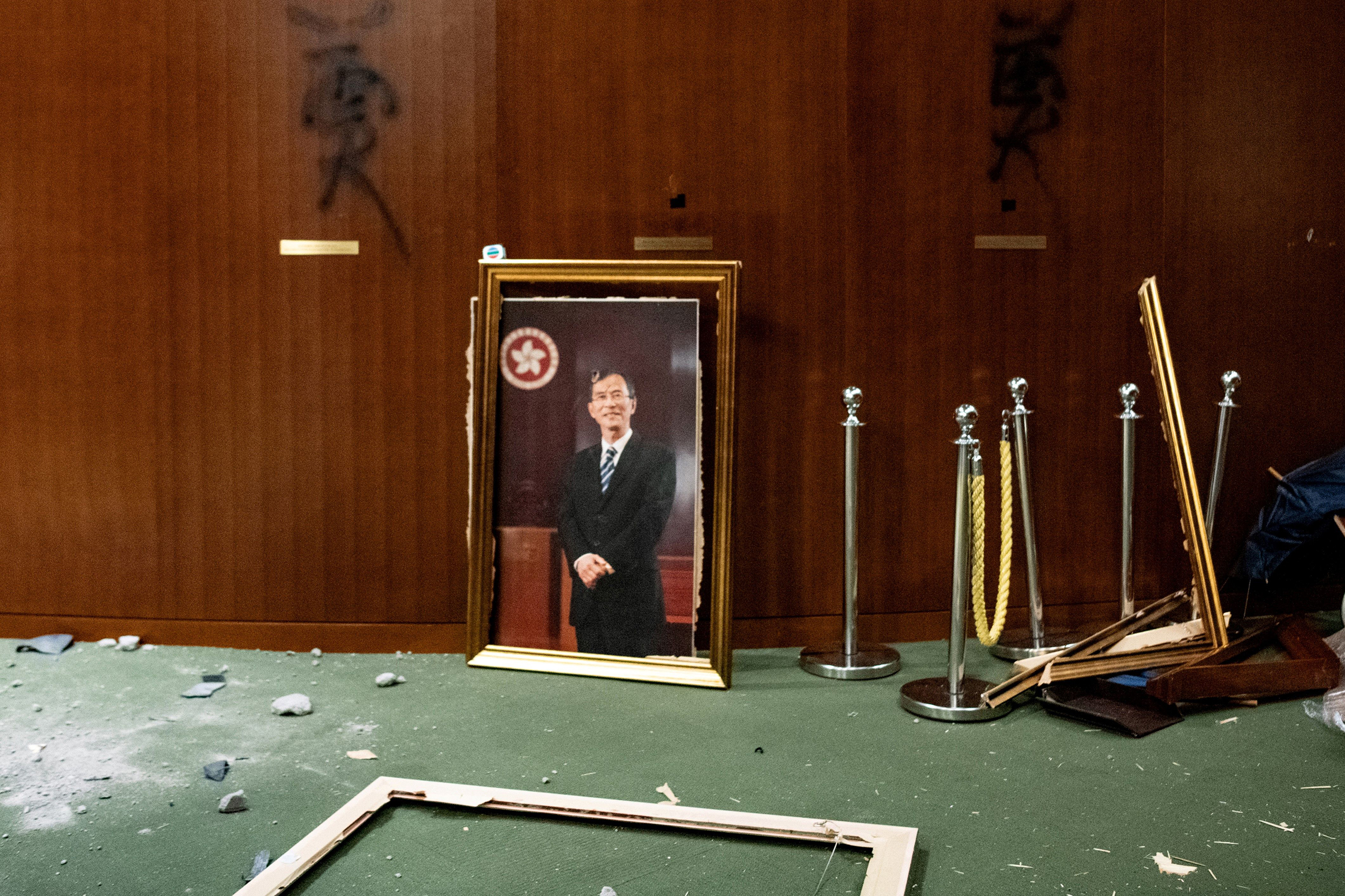 The portrait of a former chairman of the Legislative Council, Jasper Tsang, is destroyed after protesters broke into the chamber of the Legislative Council in Hong Kong on July 1, 2019.