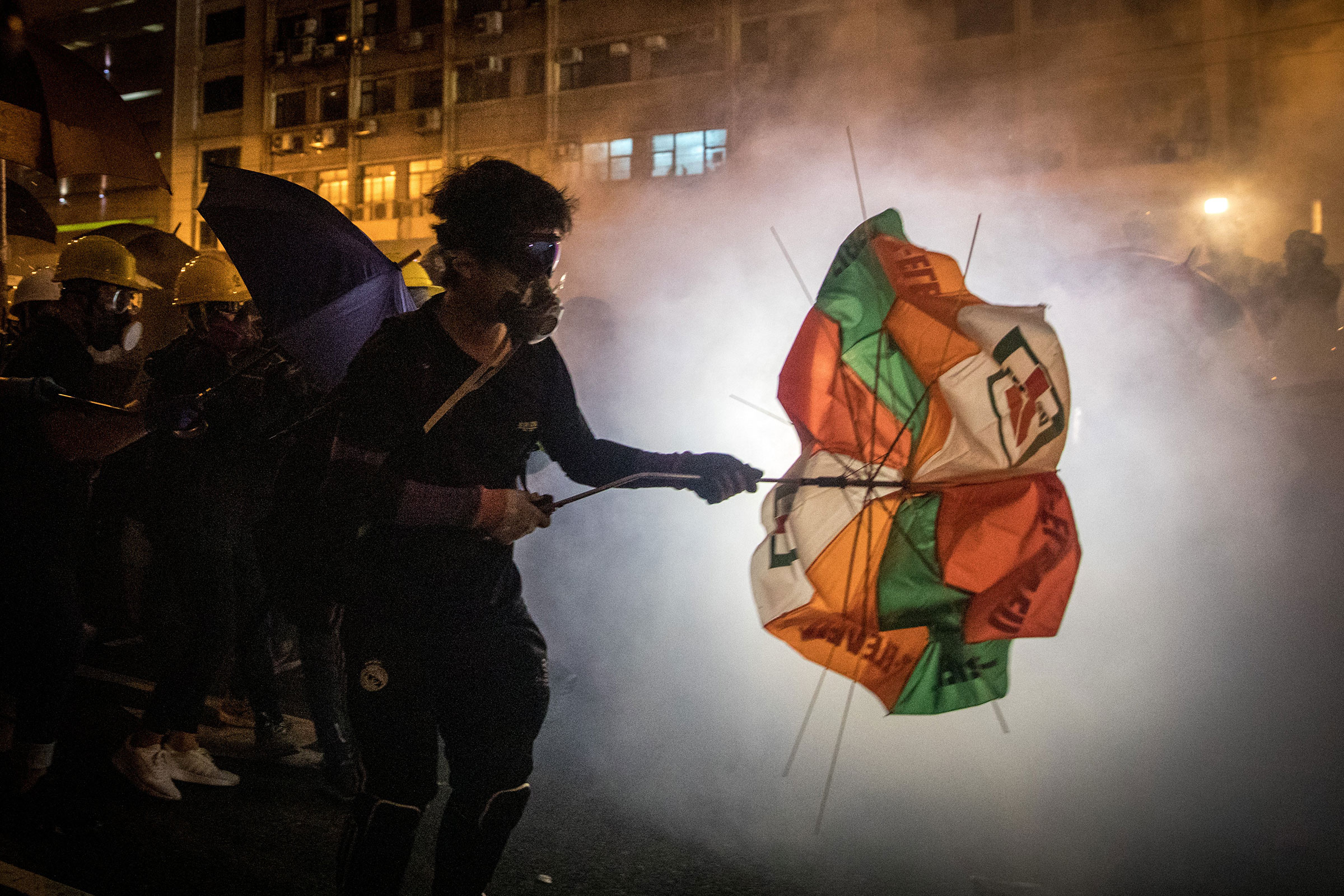 Protesters clash with police amid tear gas after taking part in an anti-extradition bill march on July 21 in Hong Kong.