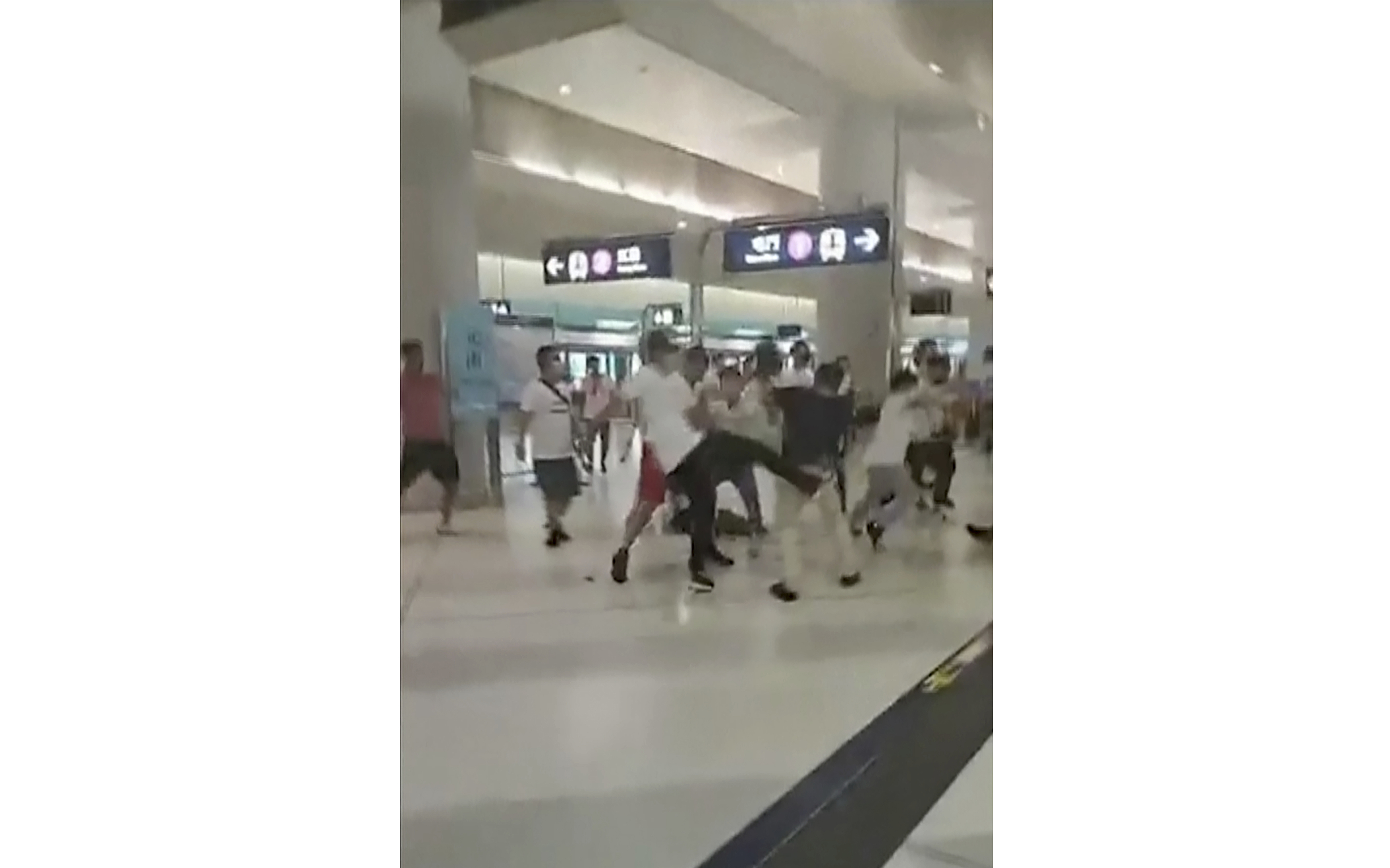 This image taken from a video shows confrontation between masked assailants and protesters at Yuen Long MTR train station in Hong Kong on July 21, 2019.