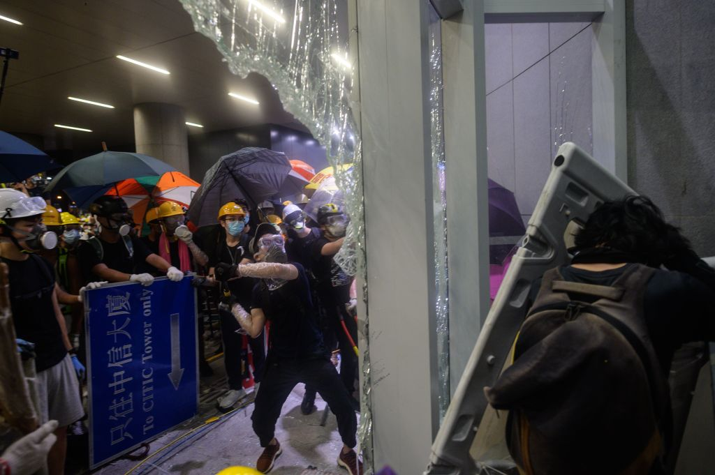 Protesters smash the glass doors and windows of the government headquarters in Hong Kong on July 1, 2019, the 22nd anniversary of the city's handover from Britain to China.